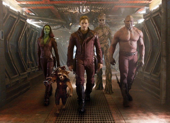 """From left, Zoe Saldana, Rocket Racoon, voiced by Bradley Cooper, Chris Pratt, the character Groot, voiced by Vin Diesel and Dave Bautista in """"Guardians Of The Galaxy."""""""