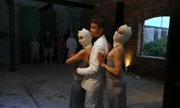 """Actors in a scene from """"Storehouse"""" at Silo City in Buffalo on Aug. 21. (Charles Lewis/Buffalo News)"""