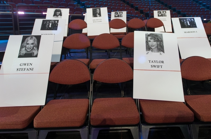 Place holders for musicians Gwen Stefani, front row left, and Taylor Swift, front row right, are displayed during a preview Thursday of the 2014 MTV Video Music Awards at the Forum in Inglewood, Calif. (Associated Press)