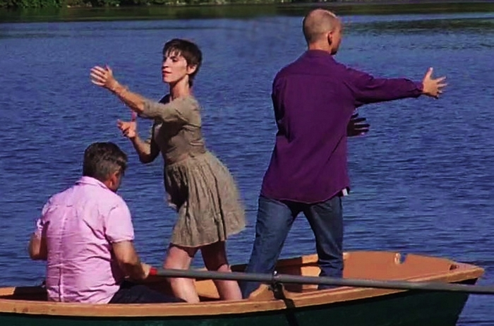 """""""Grain Dances, Steel Floats"""" will take place on land and in boats at Mutual Riverfront Park. Pictured are director David Butler rowing a boat with Nancy Hughes and Andrew Kutnyak."""
