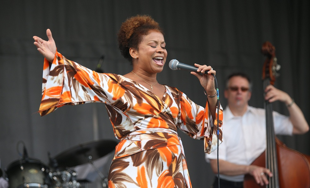 Vocalist Niki Haris, daughter of late jazz pianist Gene Harris, performs with her band at the annual Pine Grill Reunion Jazz Festival, sponsored by the African American Cultural Center, at Martin Luther King Park on Sunday. (Charles Lewis / Buffalo News)