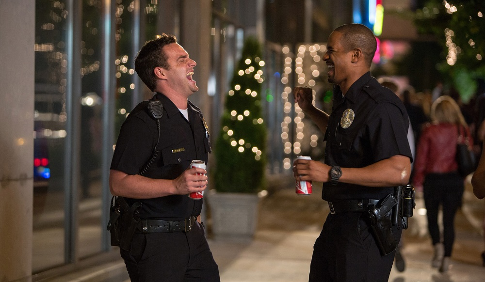 "Damon Wayans, Jr., right, and Jake Johnson in a scene from ""Let's Be Cops."" (Associated Press / Frank Masi)"