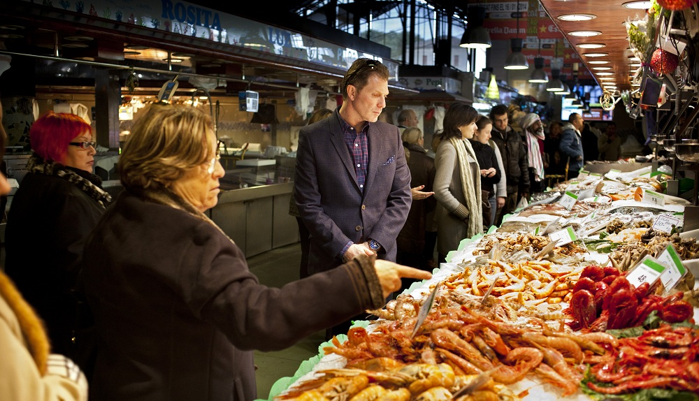 Mercado, a restaurant-based market once planned for Buffalo, not unlike this one Bobby Flay visits in Madrid, will go no further. (Lourdes Segade for The New York Times)