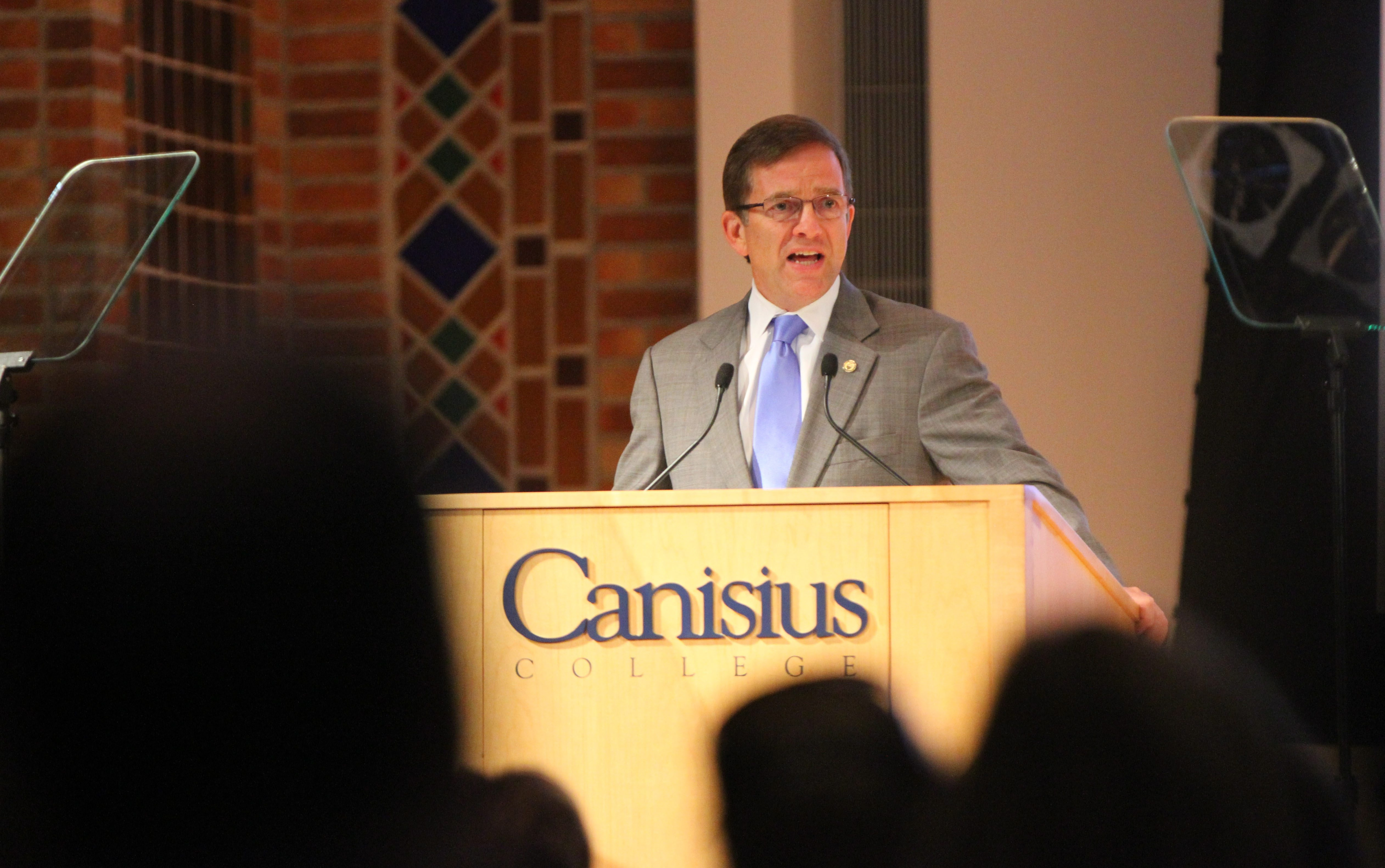 Canisius President John J. Hurley addresses the college body during convocation ceremony.