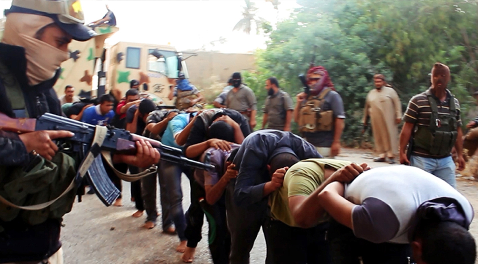 Atrocities committed by the Islamic State, which include the murder of captured Iraqi soldiers, require an international response.  (AP photo from a militant website)