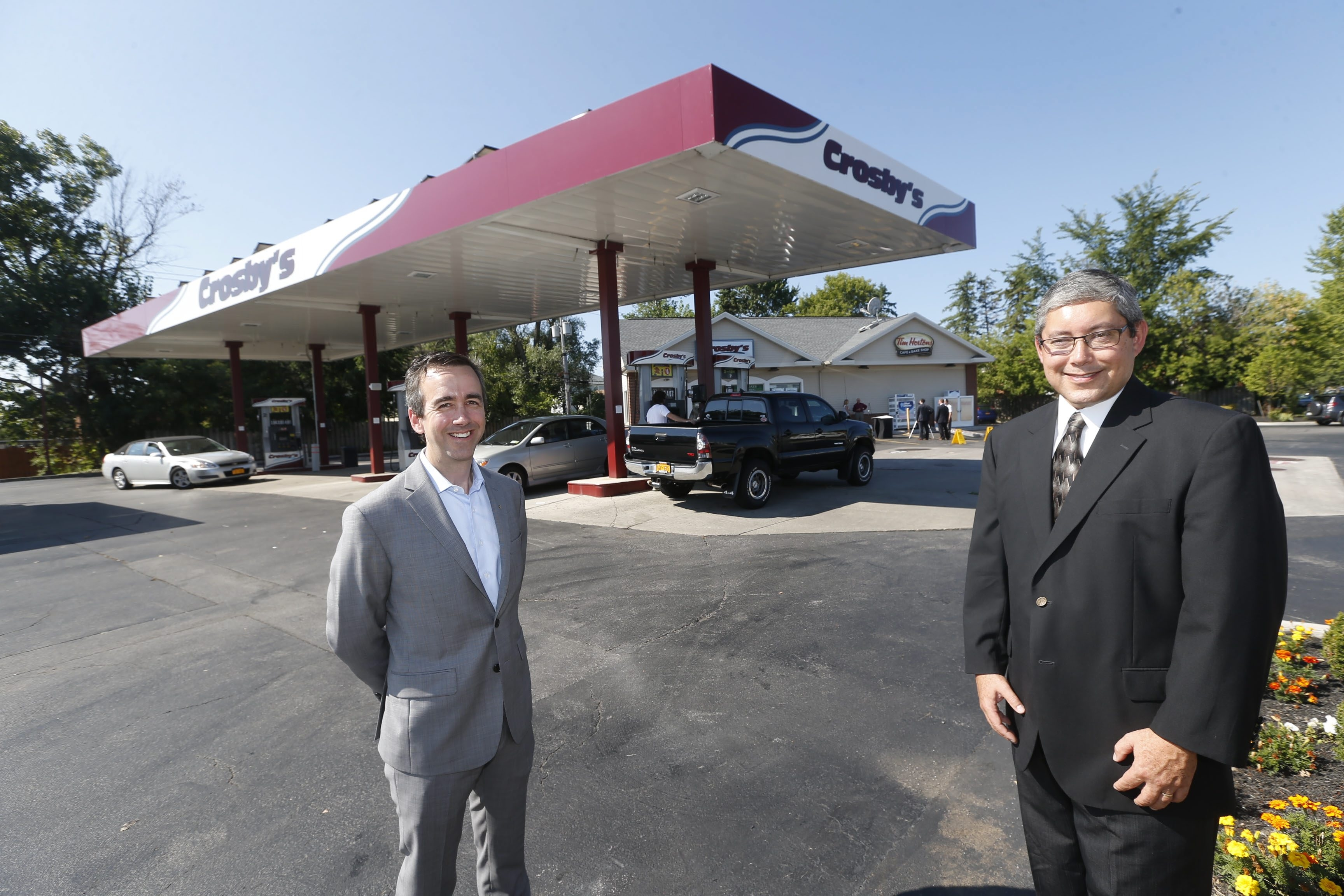 Reid Group President Paul Quebral, right, along with Montante Solar President Daniel T. Montante, announced Thursday that Crosby's Amherst store has gone solar.