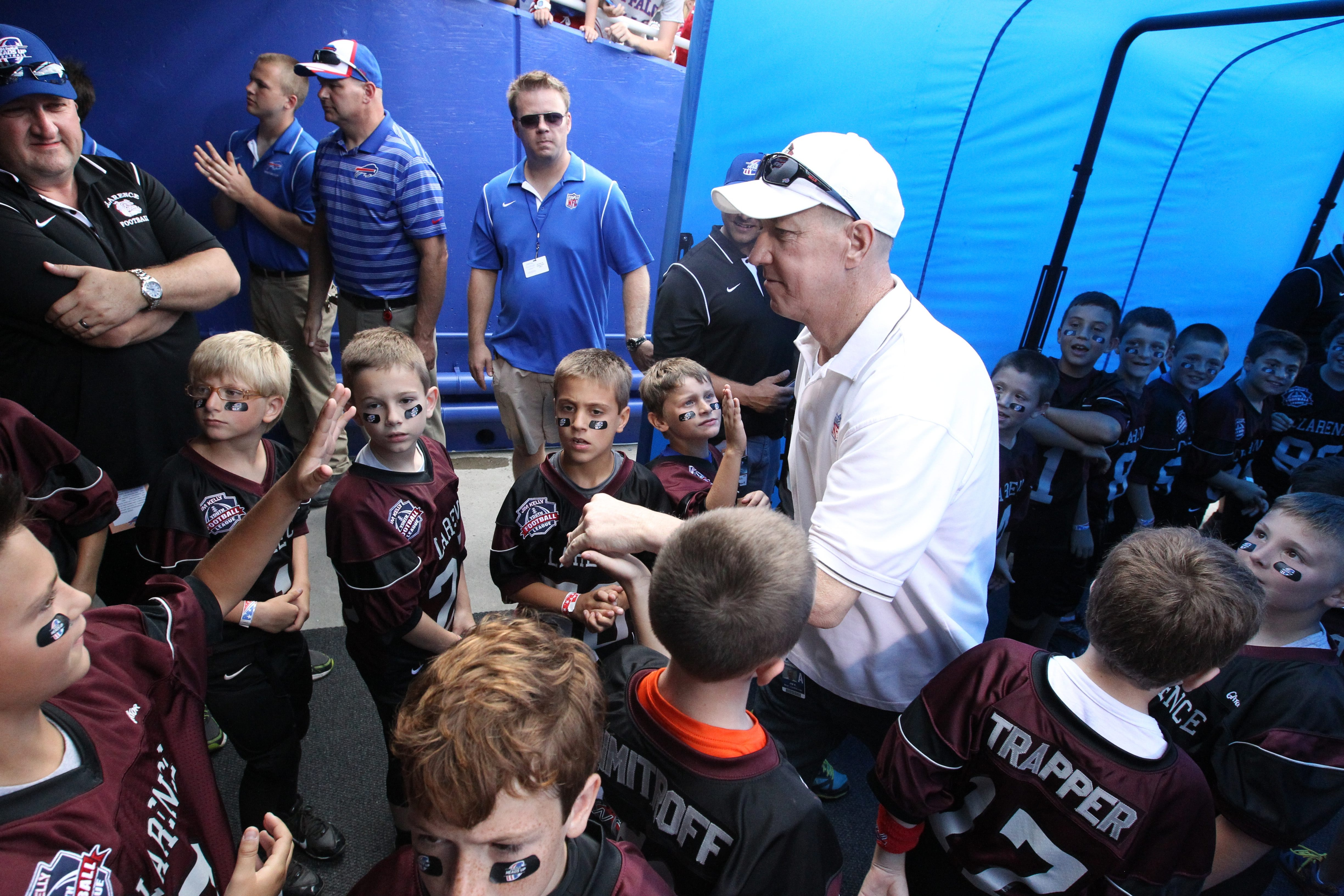 Jim Kelly surprise kids in the tunnel before the Aug. 23 game at Ralph Wilson Stadium in Orchard Park. The Kelly family on Thursday announced that Kelly's cancer is gone.