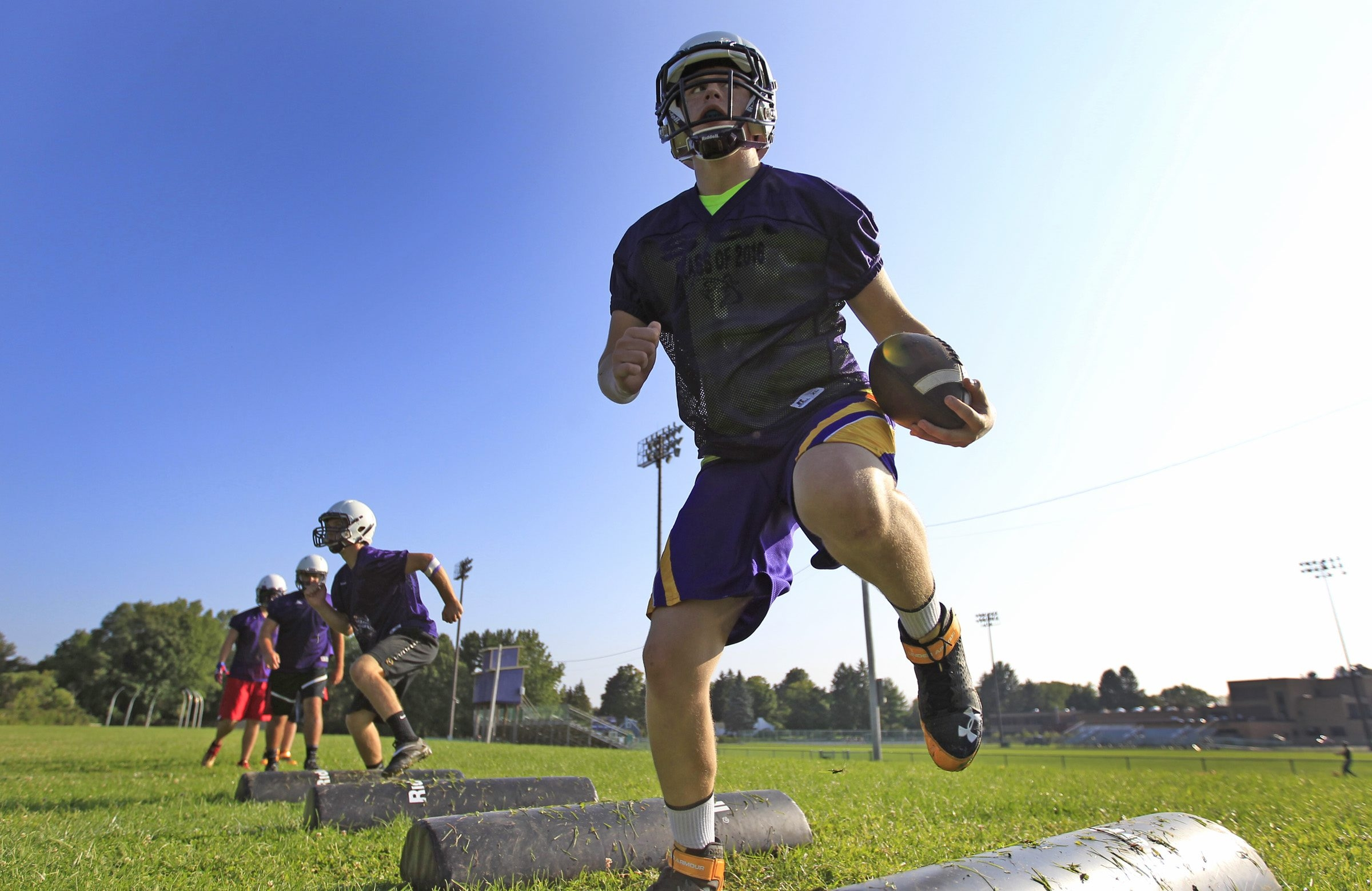 Greyson Louth from the Springville Griffins football teams runs a drill during practice on Tuesday, Aug. 19, 2014.  (Harry Scull Jr/Buffalo News)