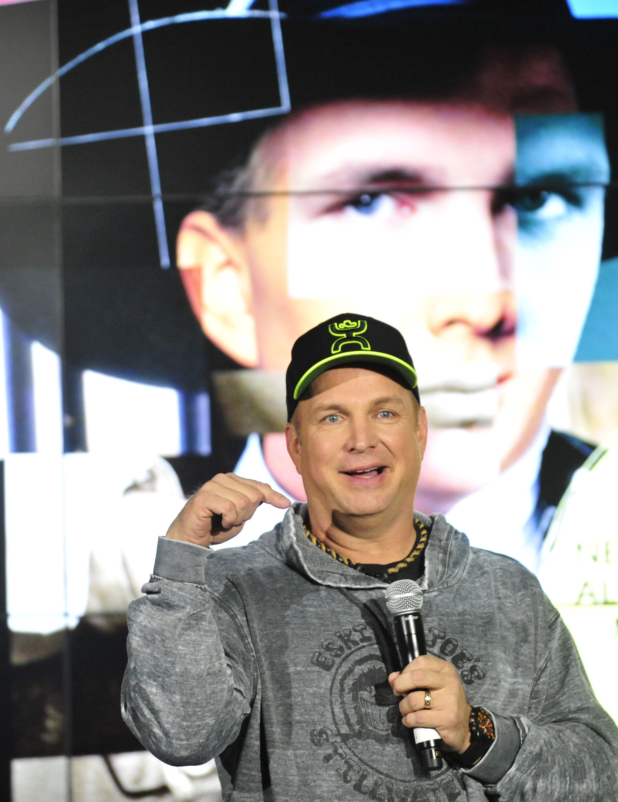 Garth Brooks talks to media Thursday in Rosemont, Ill., where he announced the launch of a digital sales service.
