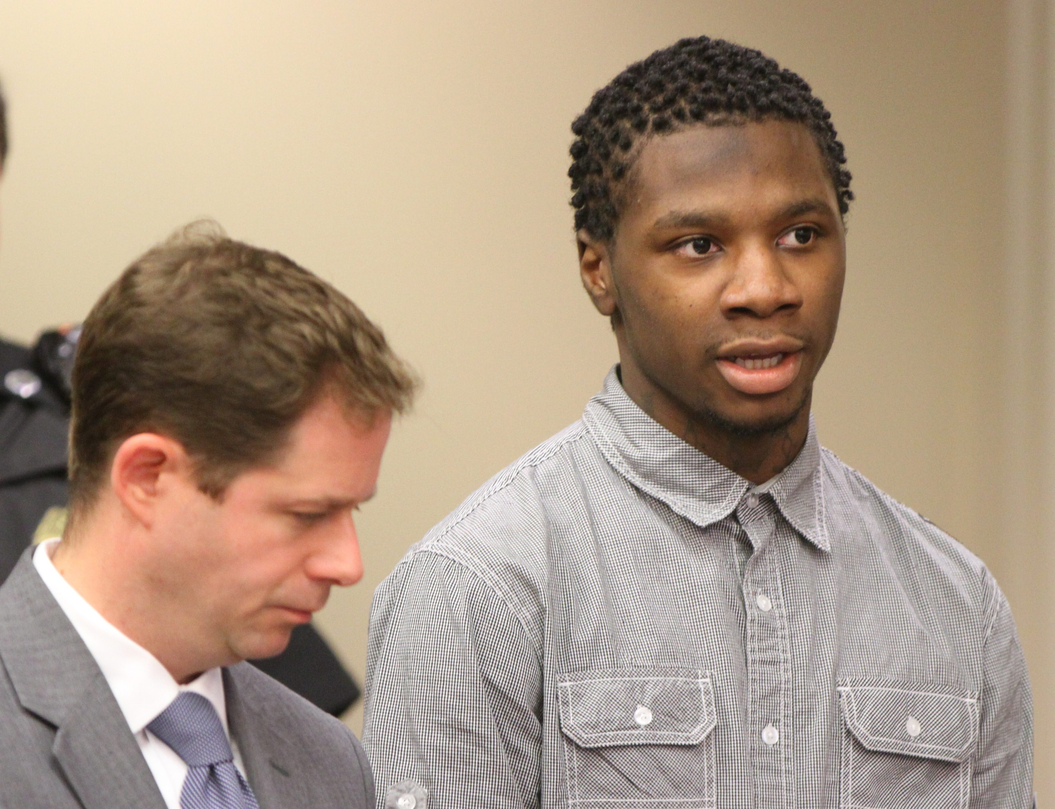 Damone Lewis, right, listens in court with his lawyer, Joseph Agro, by his side during his sentencing Tuesday.