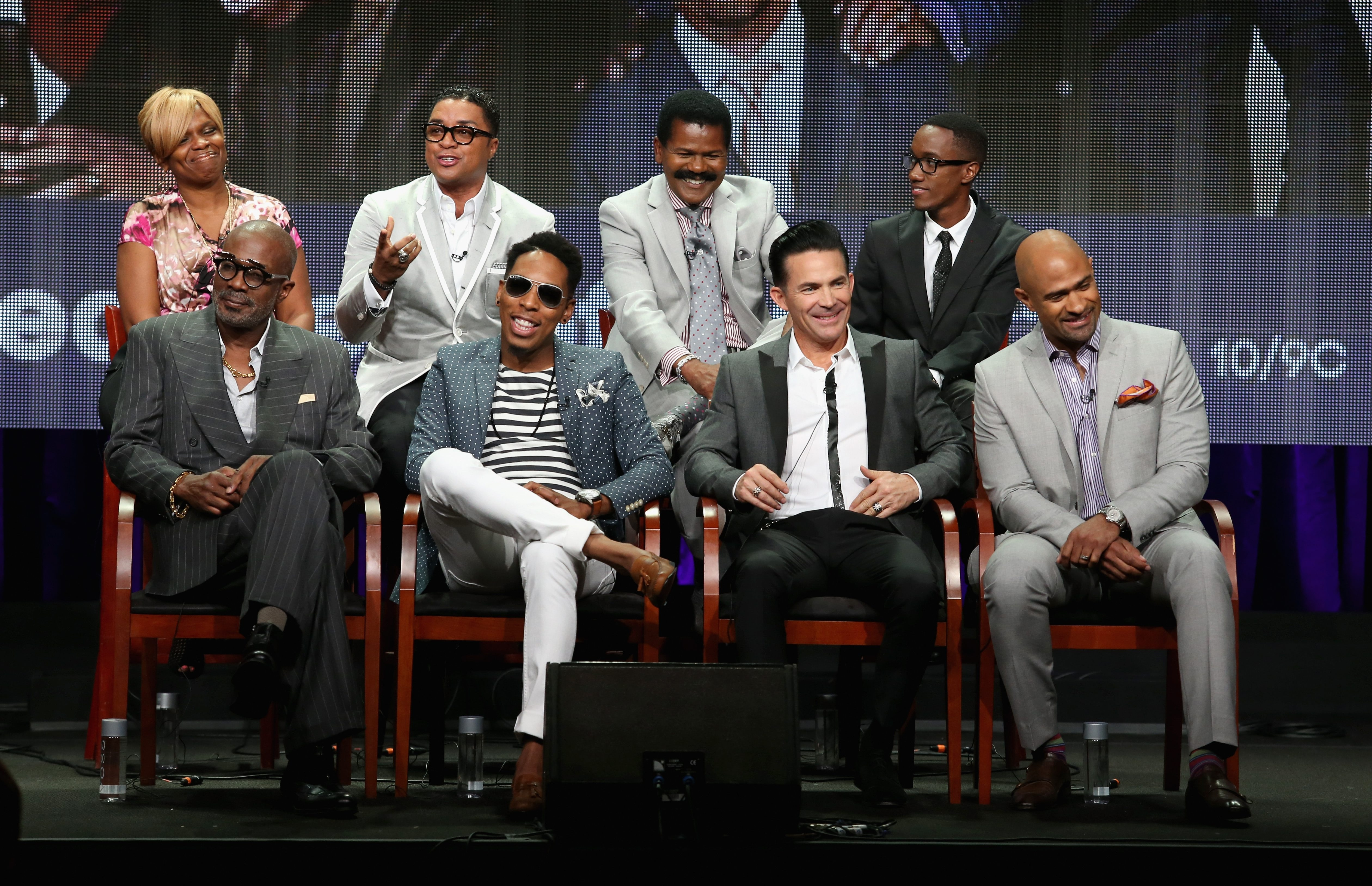 """At top, from left, executive producer Holly Carter, Bishop Clarence McClendon, Bishop Ron Gibson, producer Lemuel Plummer. Front, from left, Bishop Noel Jones, Minister Deitrick Haddon, Pastor Jay Haizlip and Pastor Wayne Chaney speak onstage at the """"Preachers of L.A."""" panel during the 2014 Summer Television Critics Association at The Beverly Hilton Hotel in July."""