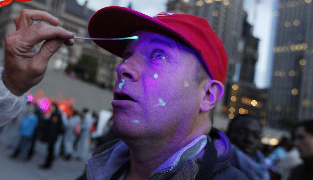 """A volunteer dabs the face and hands of Michael Bednarski of Toronto as part of """"HALFLIFE."""" (Sharon Cantillon / Buffalo News)"""