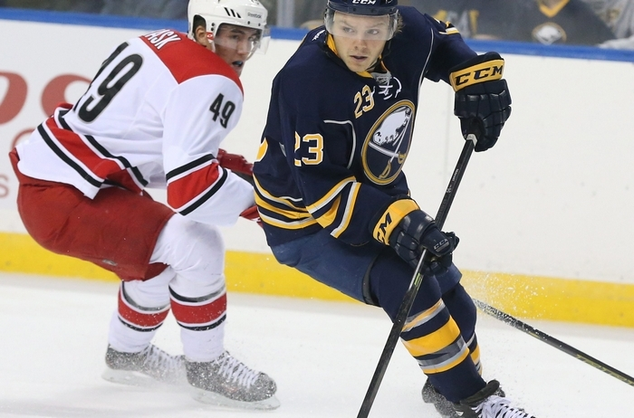 Sabres center Sam Reinhart skates with the puck past Carolina center Victor Rask in their exhibition game on Sept. 23. James P. McCoy/Buffalo News