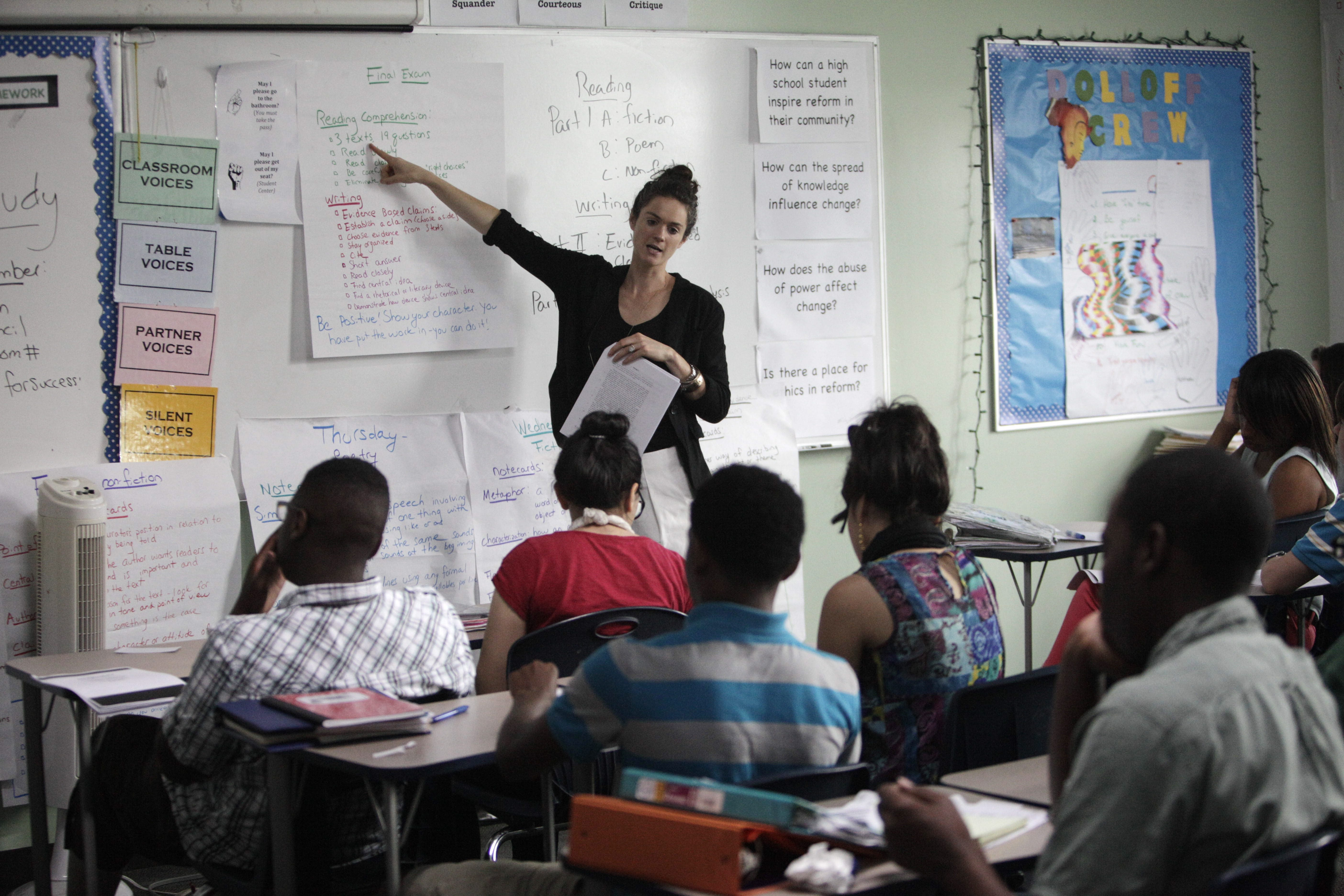 Tapestry Charter School graduates 93 percent of its students on time. Here, English teacher Sara Dolloff goes over the format of the final exam with her class at Tapestry.