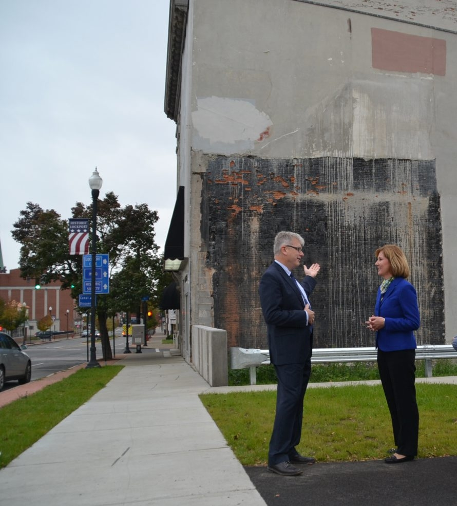 Lockport businessman George Fritz and Mayor Ann E. McCaffrey discuss the possibility of painting a mural on the side of Fritz's Main Street store.