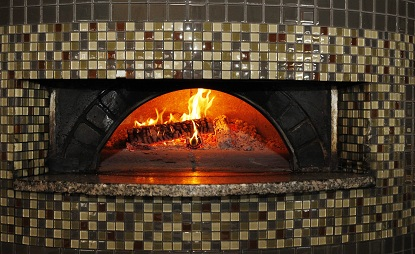 Siena is at 4516 Main St. in Snyder.  Their wood-fired brick oven is used mostly to make their thin crust pizza.  (Sharon Cantillon/Buffalo News)