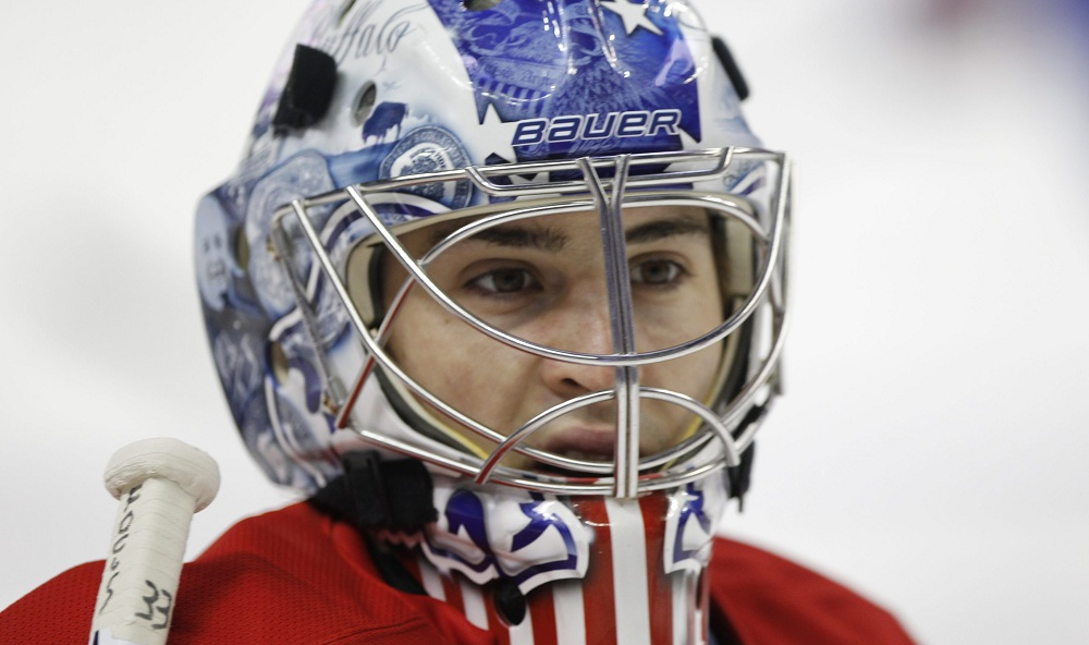 Former Amerks goalie and Williamsville native David Leggio pulled out a move from his goalie bag of tricks on Sunday. (Harry Scull Jr. / Buffalo News file photo)