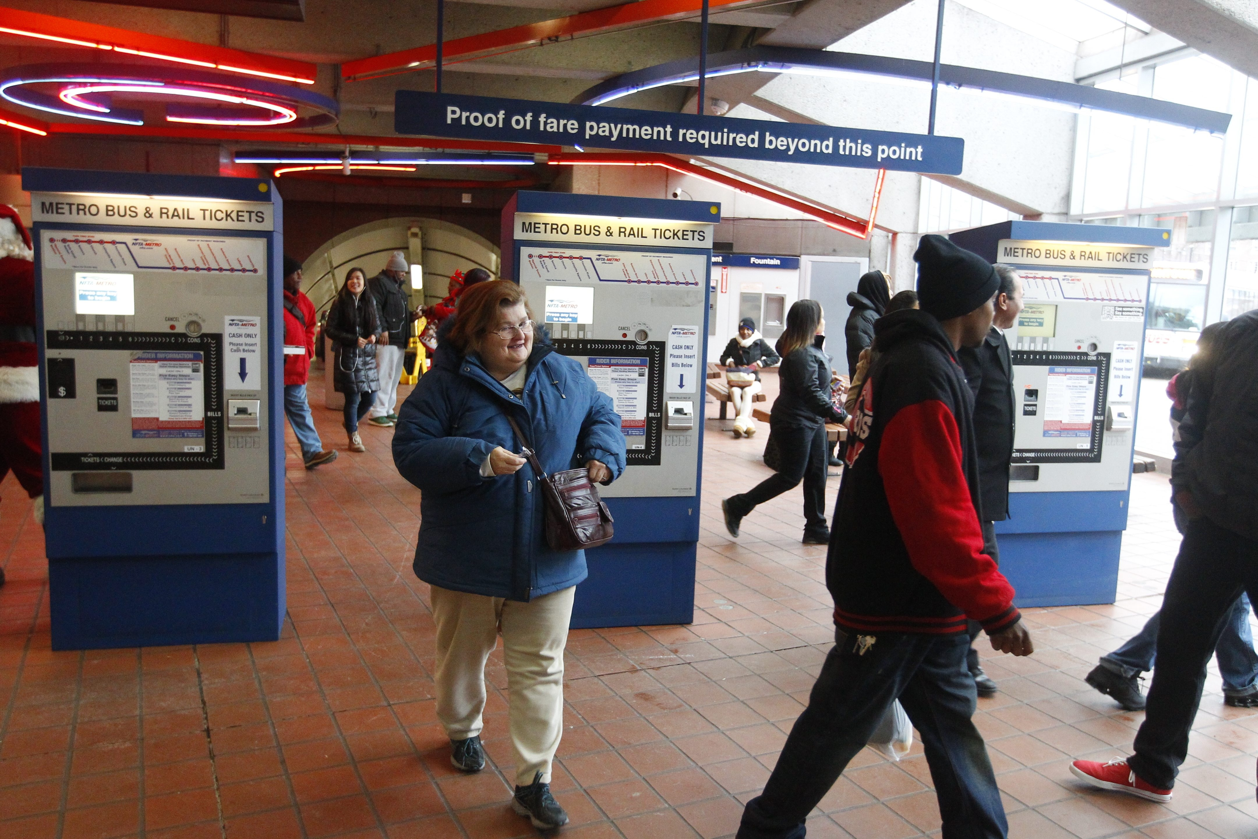 NFTA Metro Rail passengers exit past ticket machines on the upper level of the University Metro Rail Station in Buffalo on Thursday.