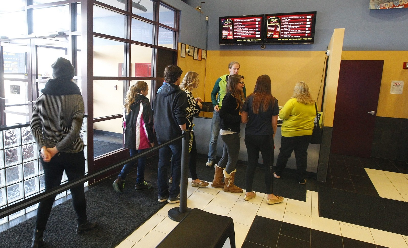 """Patrons arrive at the Lancaster Dipson Flix Theatre for the first showing locally of """"The Interview."""" (John Hickey/Buffalo News)"""