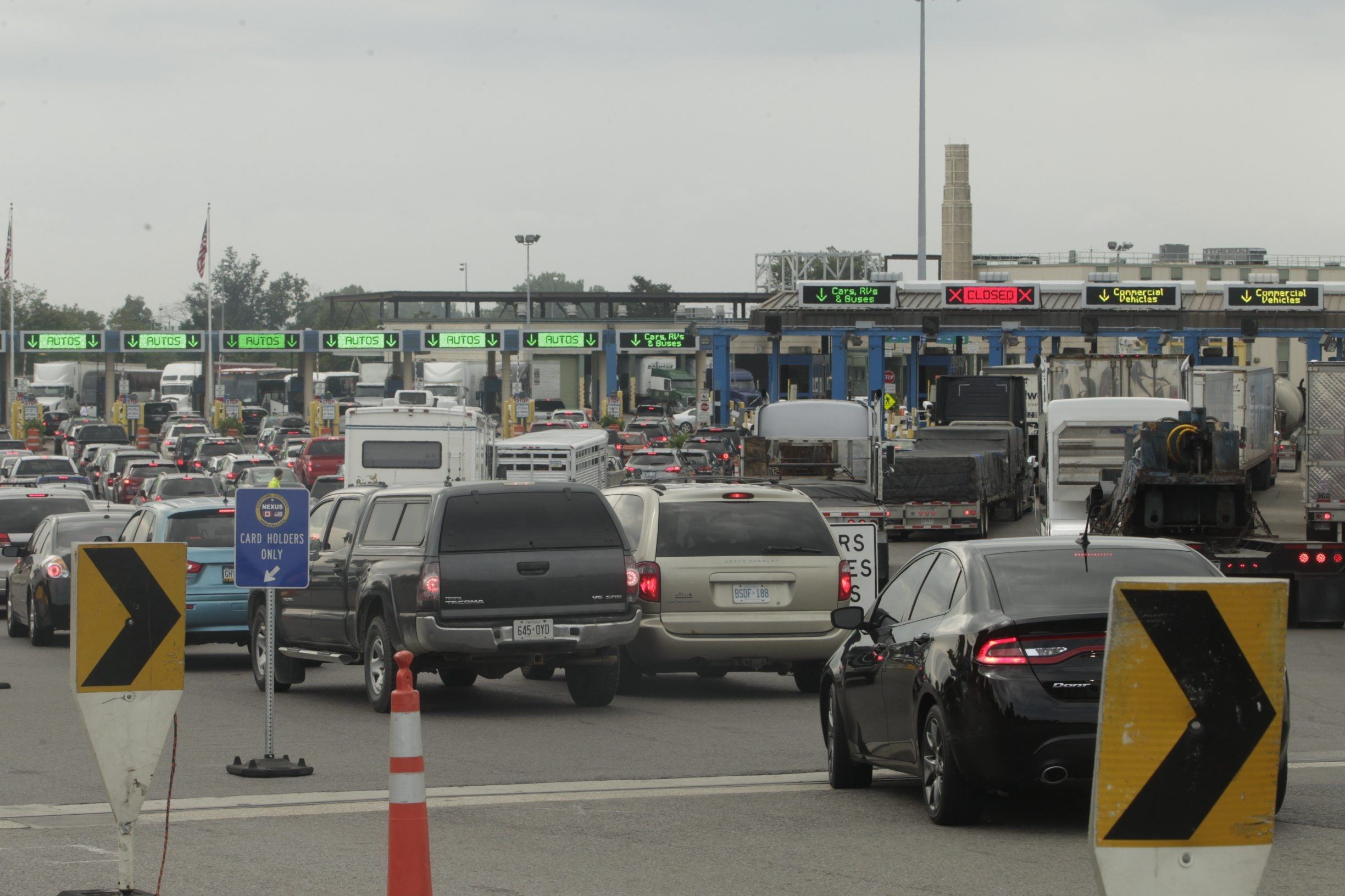 Lines of traffic wait to enter the United States from Canada at the Peace Bridge in Buffalo last summer. A House GOP plan to require biometric testing of everyone leaving the country would create epic traffic jams, some say. (John Hickey/Buffalo News)