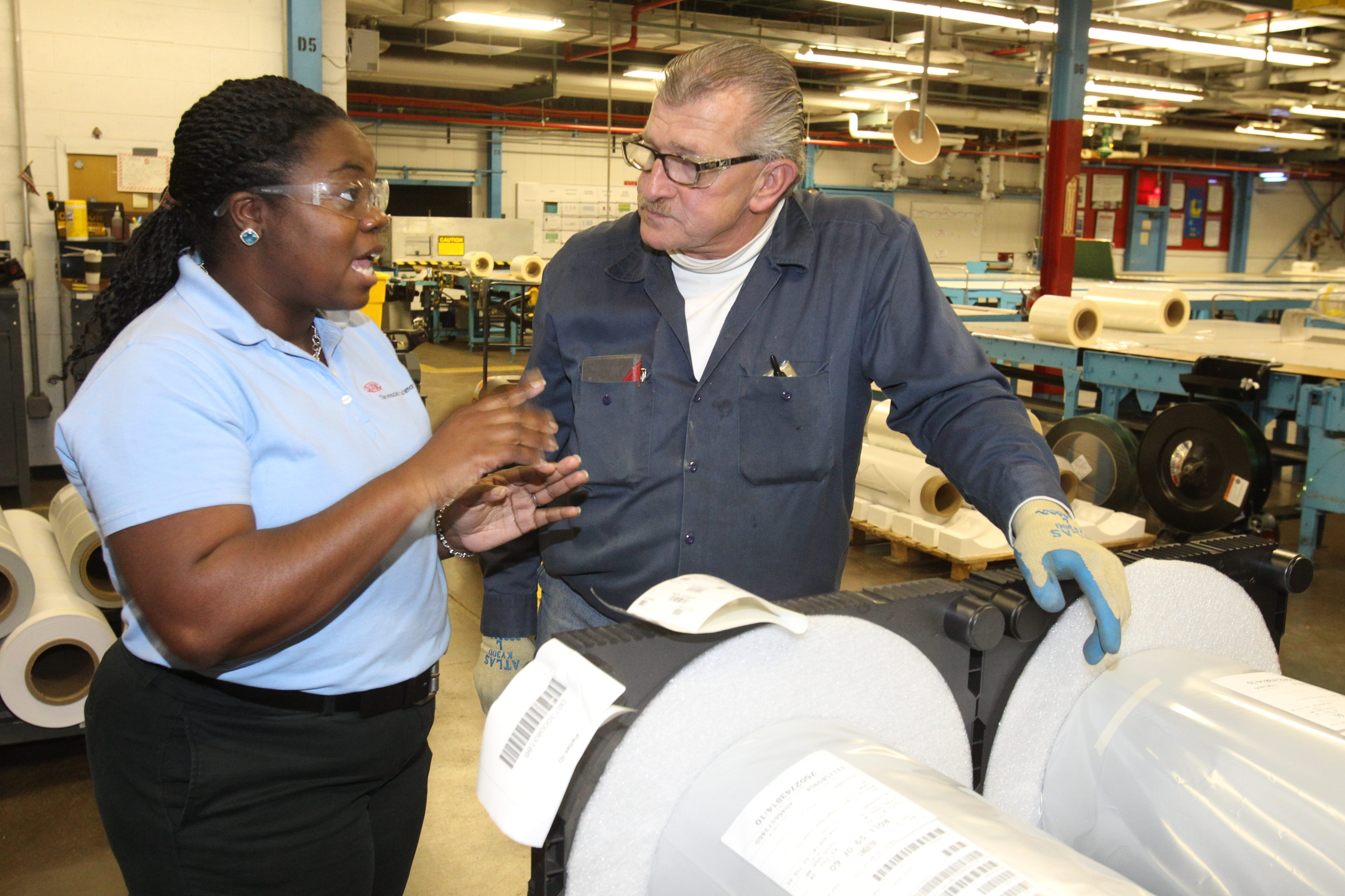 Myoshi Aubain, production manager for the Tedlar unit, talks with finishing section operator Tom Meaney at the DuPont Yerkes Plant in the Town of Tonawanda. In December, Buffalo Niagara factories reported better productivity amid a slump in hiring.