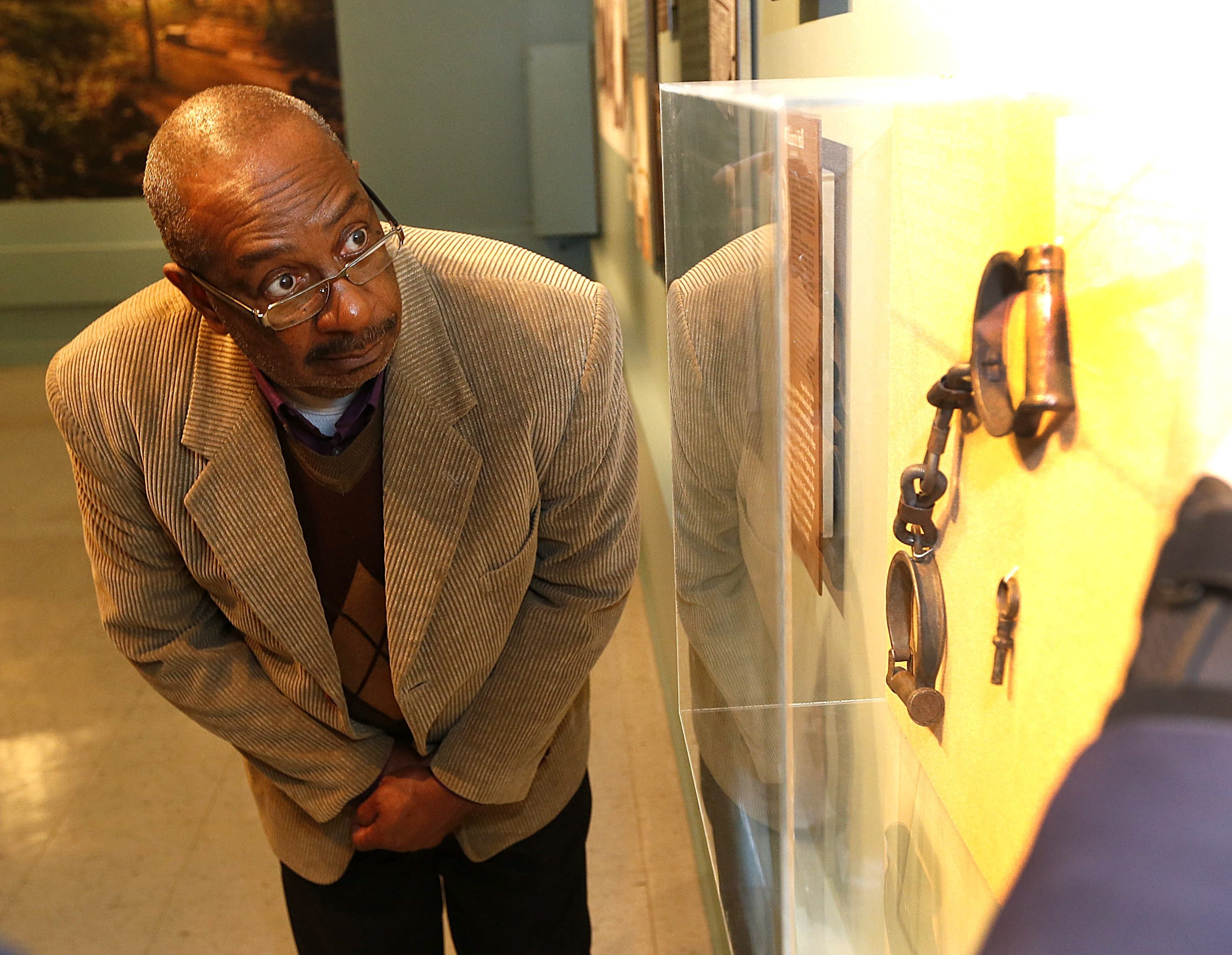 Hezekiah Watkins, 67, a former Freedom Rider who once shared a jail cell with the Rev. Martin Luther King Jr. in Jackson, Miss., looks at slave ankle cuffs at the Castellani Art Museum at Niagara University during his visit to the Underground Railroad exhibit.