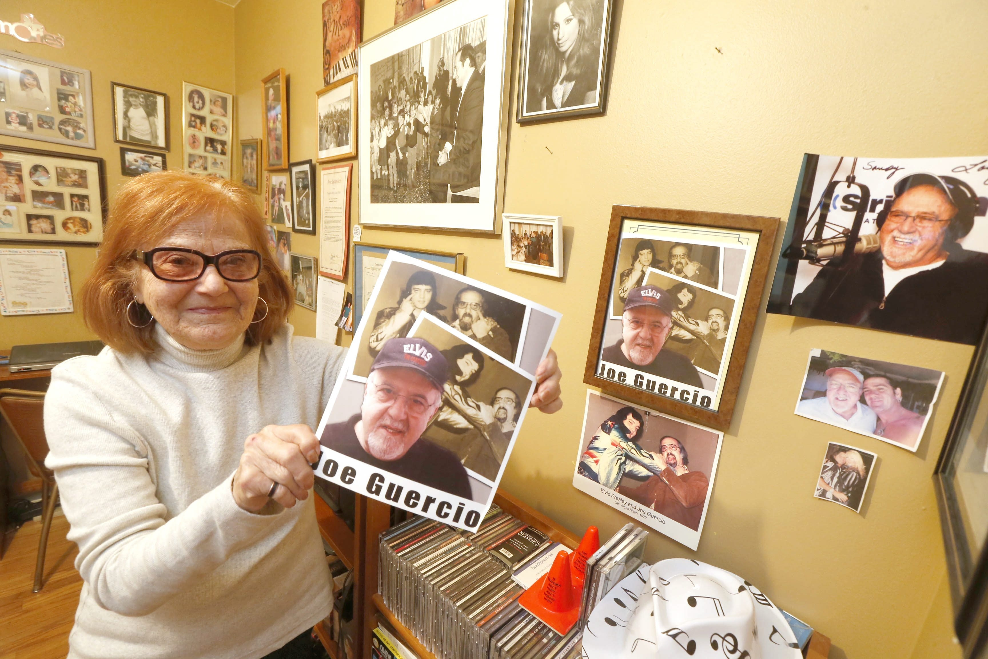 Sandy Gerace holds a photo of her brother Joe Guercio, who was Elvis Presley's musical director for years.  This at her home in Tonawanda on Friday, Jan. 9, 2015.  (Robert Kirkham/Buffalo News)