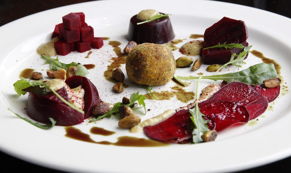 Beets Five Ways from the Black Sheep: Carpaccio, roasted, pickled, budino and tartare with goat cheese truffle and pistachio vinaigrette. (Sharon Cantillon/Buffalo News)