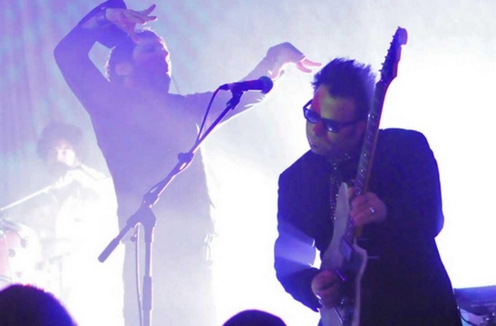 Jonathan Donahue (left) and Grasshopper (right) of Mercury Rev performing in Europe during the summer of 2012.