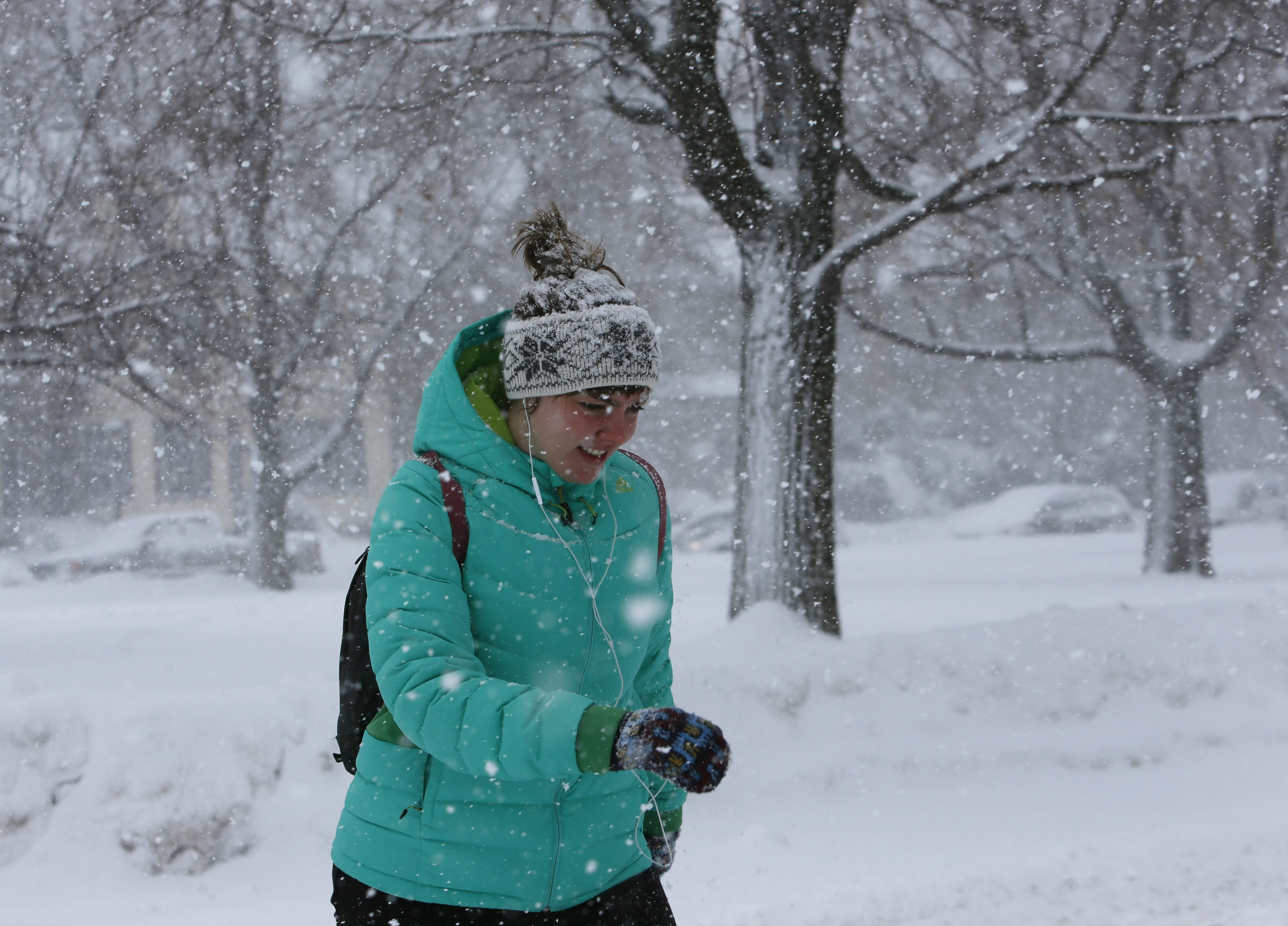 Elsa Bragadottir of Buffalo trudges through snow on Bidwell Avenue in Buffalo on her way to the gym, Saturday, Feb. 14, 2015.  (Derek Gee/Buffalo News)
