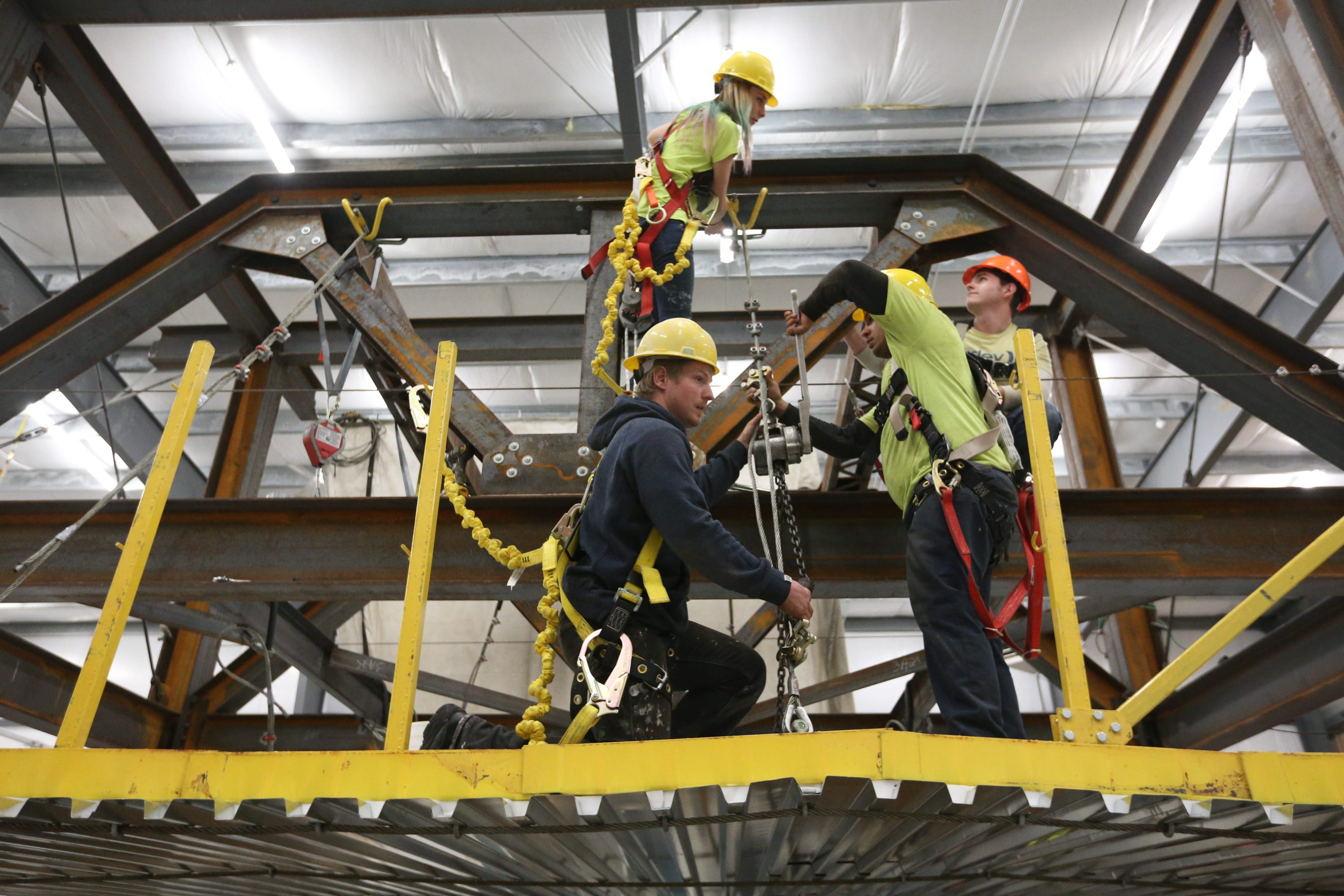 vocational training school opens new educational center the kristina rogers on upper level miguel albarran and rich roehm show off their skills at the ribbon cutting of the finishing trades institute of wny