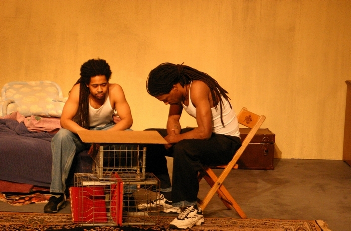 """Amilcar Hill and Preach Freedom play brothers facing daunting odds in Ujima Theatre's """"Topdog/Underdog."""""""