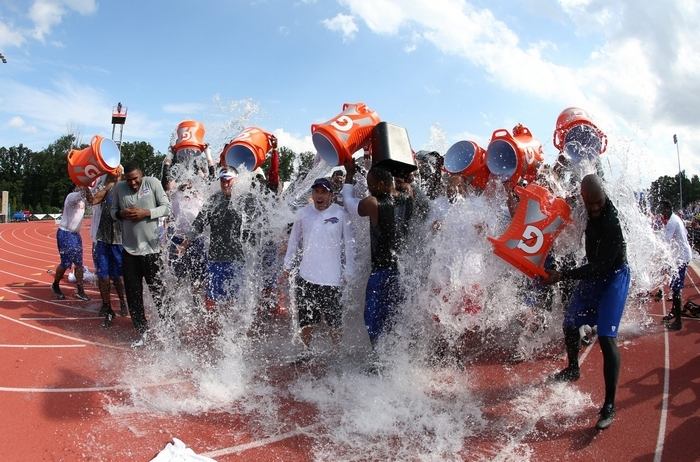 Russ Brandon and the Buffalo Bills get buckets of ice water dumped over them  Tuesday as part of the ice bucket challenge, which has drawn attention  – and money –  to the fight against Lou Gehrig's disease. See a photo gallery at BuffaloNews.com (James P. McCoy/Buffalo News)