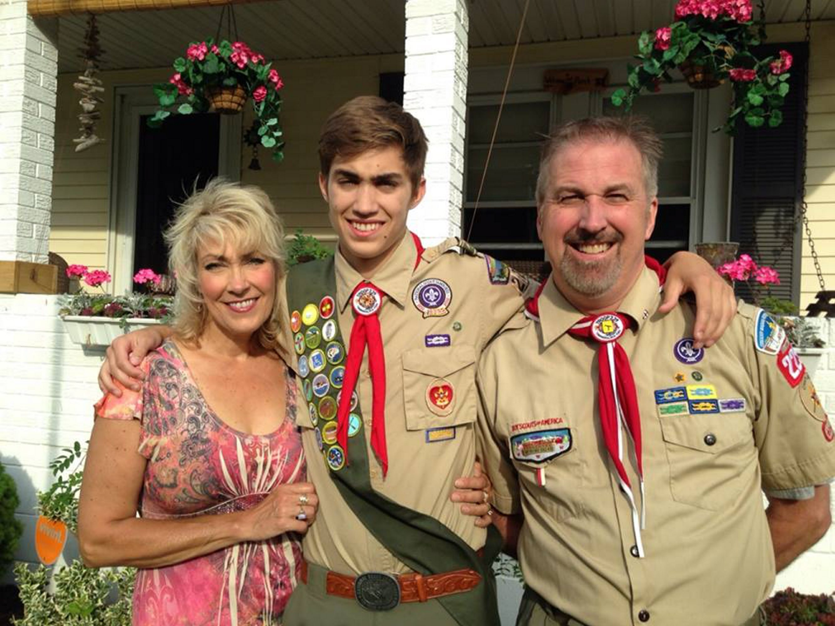 Jed Woomer, center, with his parents on June 10, 2014. Jed was an Eagle Scout and 2014 Tonawanda High School graduate who died April 8 after cancer surgery.