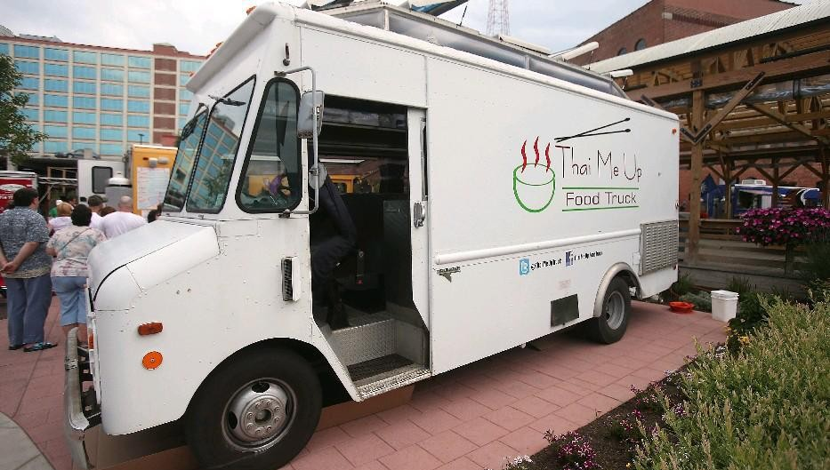 The owner of the Thai Me Up food truck said he plans to continue operating the truck after opening his Lancaster restaurant. (Robert Kirkham/Buffalo News)