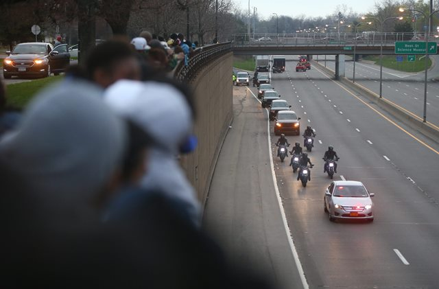 """Fans cheer for stunt motorcyclists Monday as they ride along the Kensington Expressway before the filming of scenes for """"Teenage Mutant Ninja Turtles 2"""" was to being Monday night. The expressway will be closed each night from 7 p.m. to 6 a.m. through May 17. (Mark Mulville/Buffalo News)"""