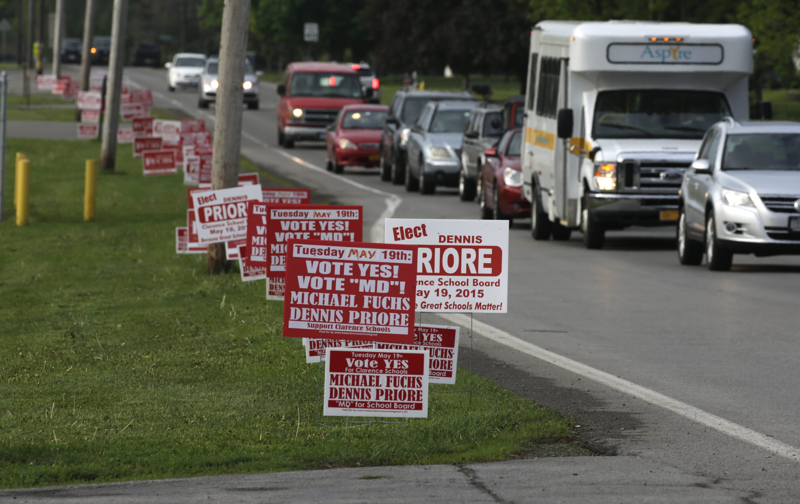 Vehicles pass signs along Gunnville Road as vote on Clarence School Budget and board election takes place at Clarence High School in Clarence, N.Y., on Tuesday, May 19, 2015.   (John Hickey/Buffalo News)