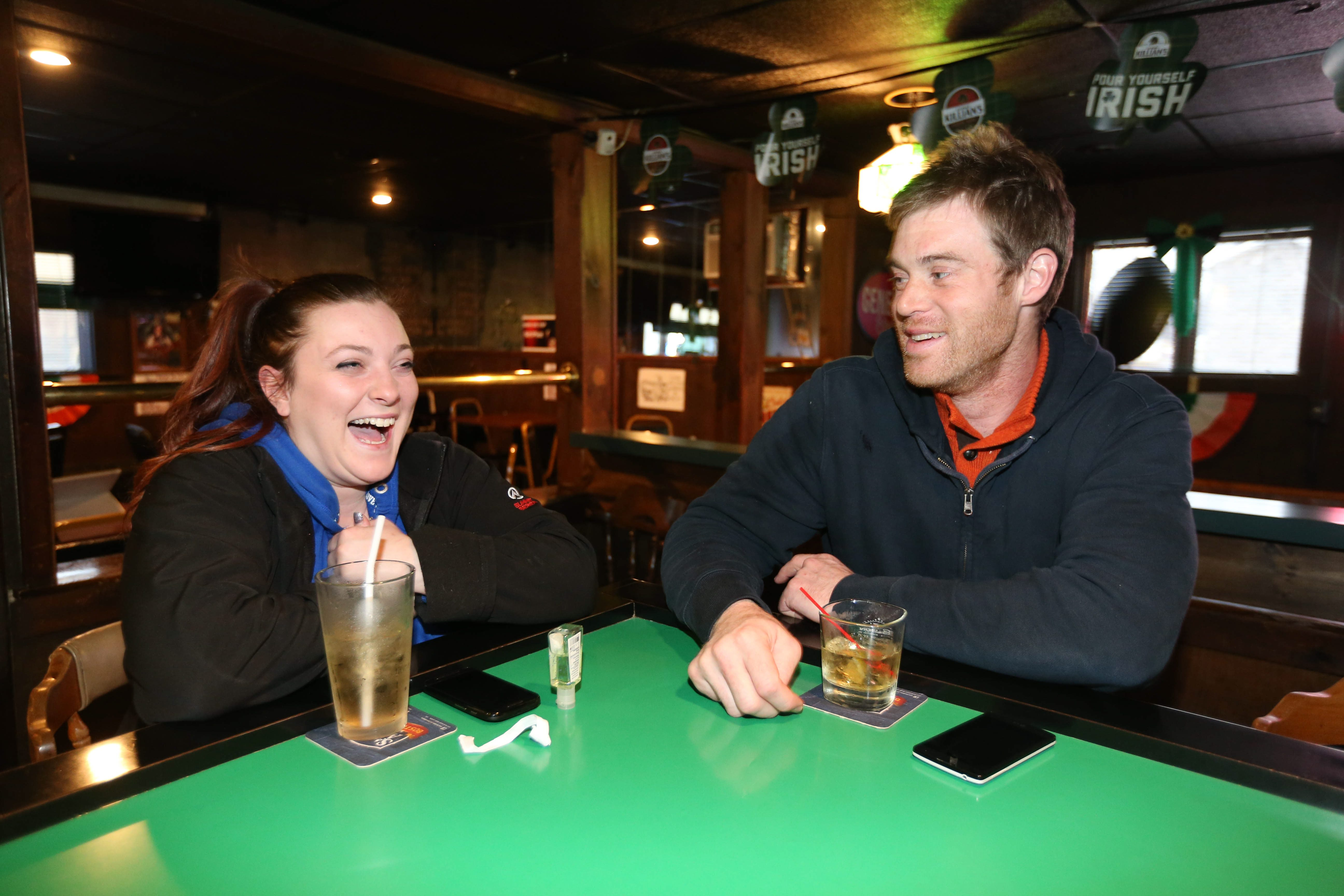 Katie Wagner and Chris Farrell of Lockport enjoy some laughs and drinks at the Pleasant Valley Tavern in Lockport.