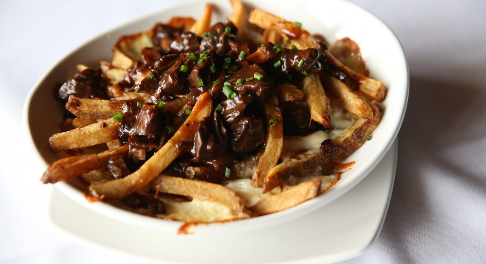 The beef shank poutine from the Colden Mill with fries, braised beef, beef gravy and cheddar curd. (Sharon Cantillon/Buffalo News)