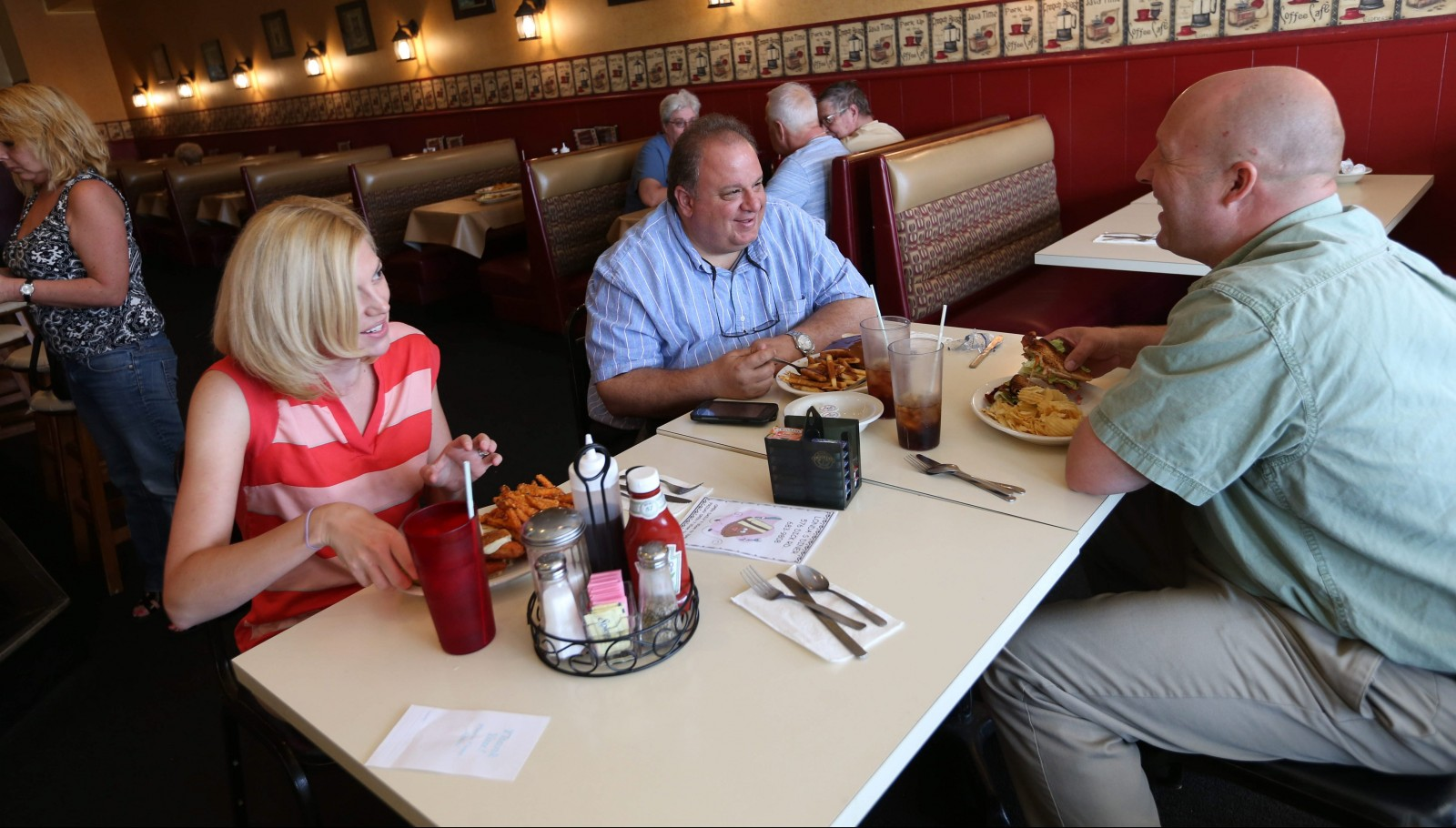 Co-workers Jamie Constantine, left, Jeffrey Levy and William Maxwell have lunch at Londa's in Depew every Friday. (Sharon Cantillon/Buffalo News)
