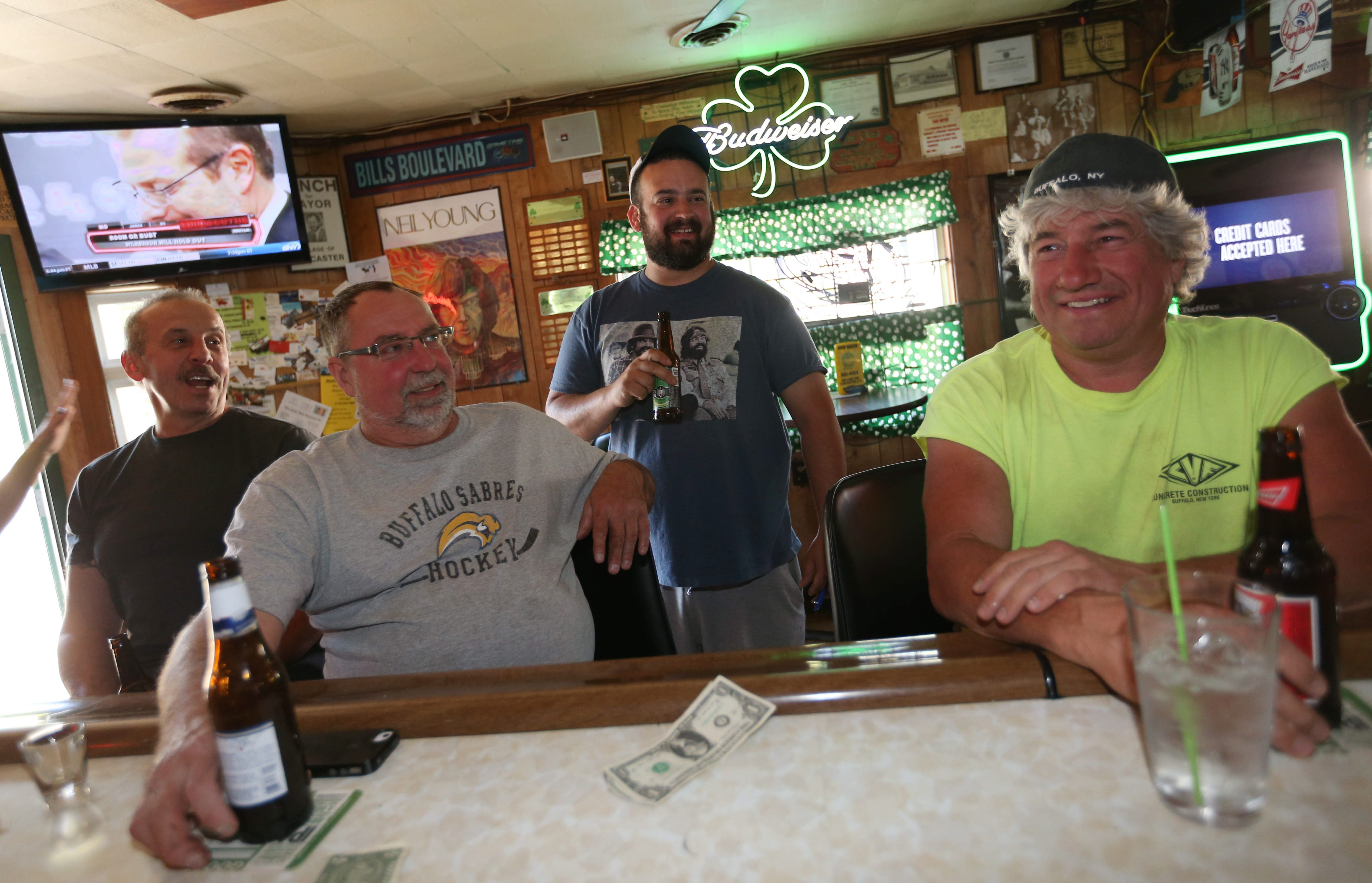 The Green Buffalo Pub is a popular neighborhood bar at 165 Lake Ave. in Lancaster. Hanging out from left are Mike Baicco, Jim Koperi, Tony Slawiak and Ron Gaca of Lancaster. To view a photo gallery, visit buffalonews.com.