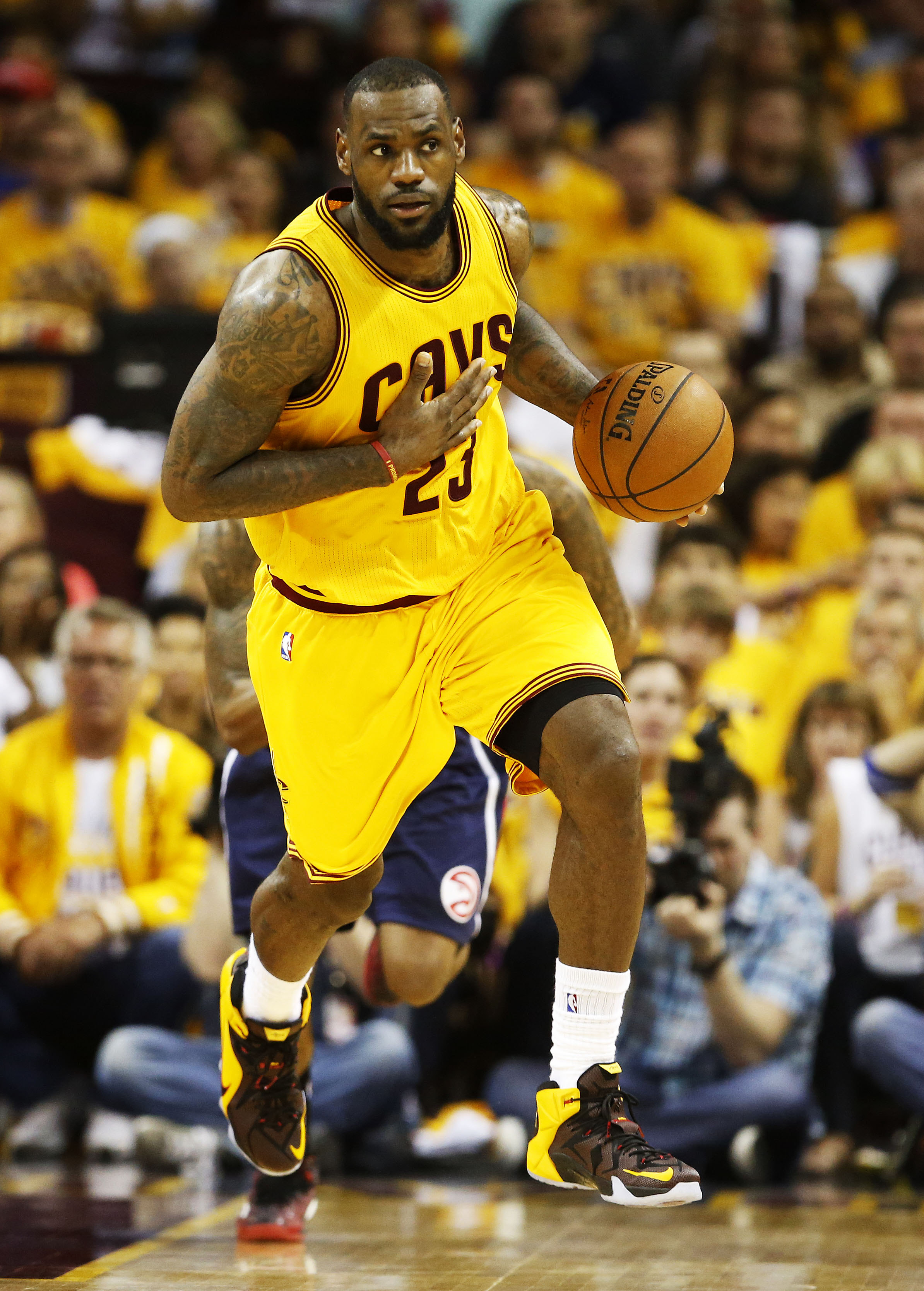CLEVELAND, OH - MAY 24:  LeBron James #23 of the Cleveland Cavaliers drives against the Atlanta Hawks in the third quarter during Game Three of the Eastern Conference Finals of the 2015 NBA Playoffs at Quicken Loans Arena on May 24, 2015 in Cleveland, Ohio. NOTE TO USER: User expressly acknowledges and agrees that, by downloading and or using this Photograph, user is consenting to the terms and conditions of the Getty Images License Agreement.  (Photo by Gregory Shamus/Getty Images)