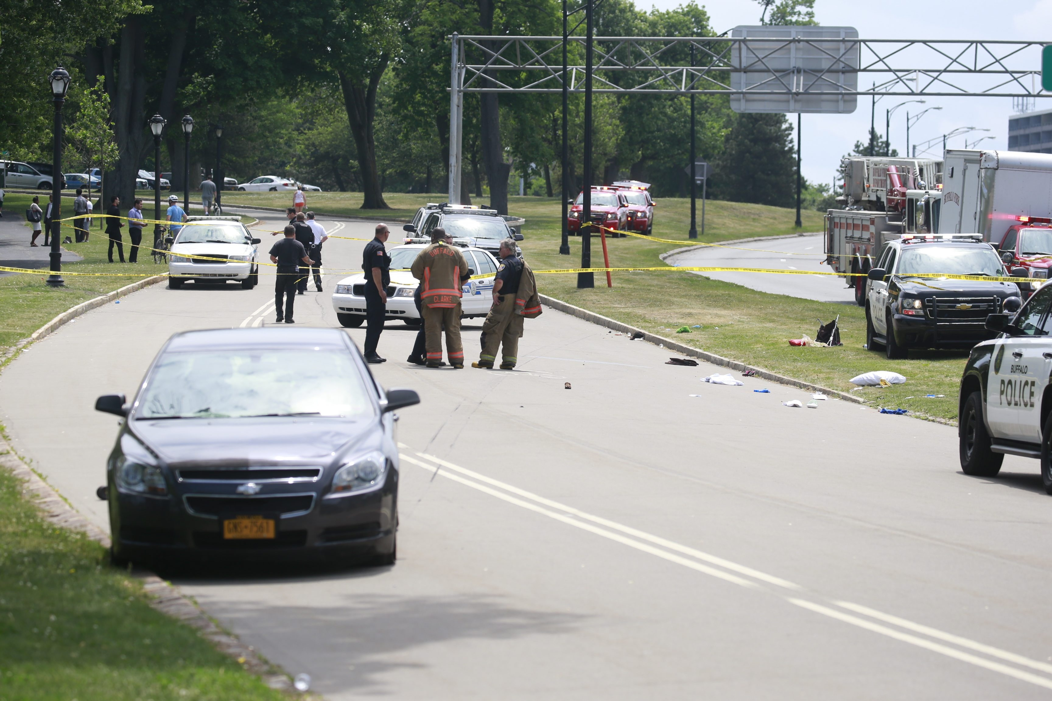 Police investigate the scene of the crash on the Ring Road at Delaware Park where the vehicle at left drove off the Scajaquada Expressway and struck a woman and two children Saturday. One of the children, a 3-year-old boy, died, and the other, a 5-year-old girl, is in critical condition.John Hickey/Buffalo News