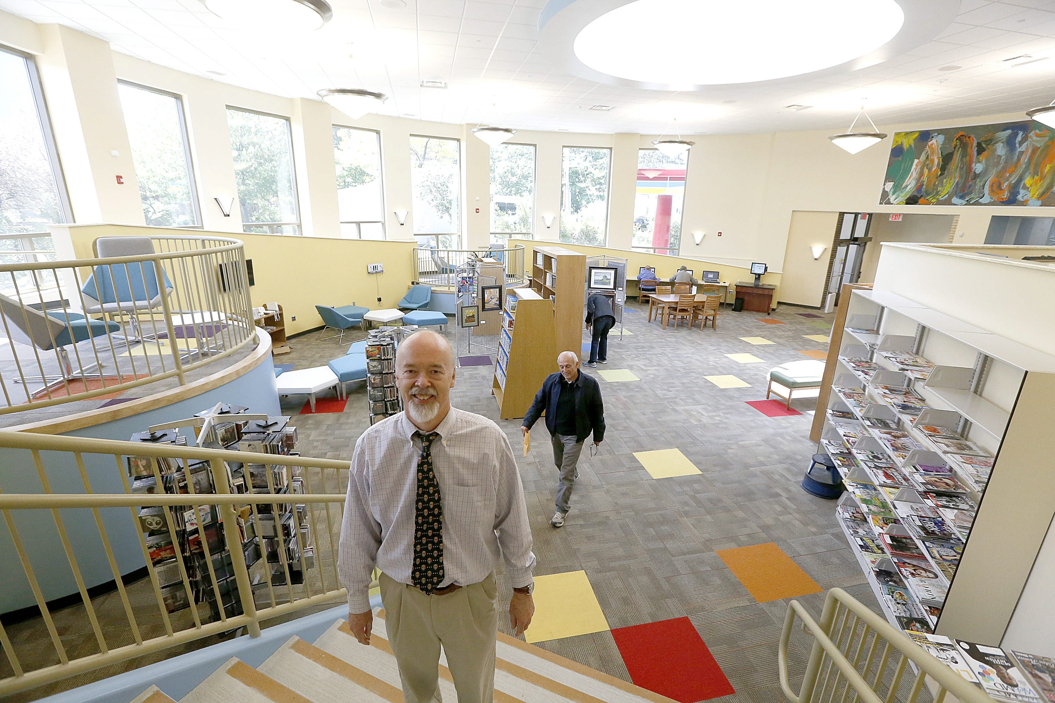 Library Director Jack Edson at the recently remodeled and expanded Hamburg Public Library on Wednesday. He noted that years ago, visitors were expected to sit quietly and refrain from eating. That's no longer the case.