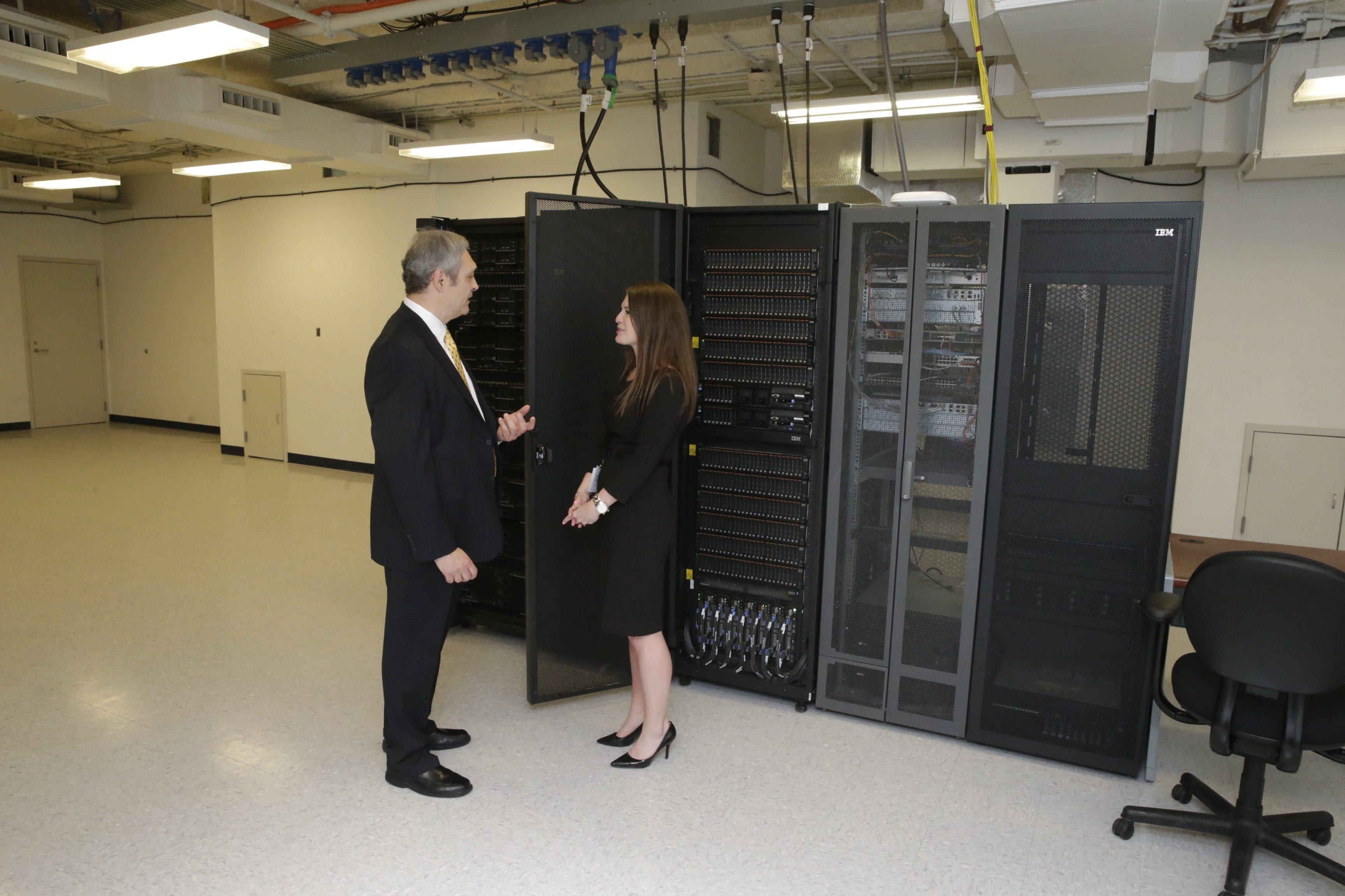 Frank Marzolini, operations executive, and Beth Stubbe, talent development lead, show off the server room at KeyCenter on Friday.  IBM expects to hire people with skills in building computing solutions.