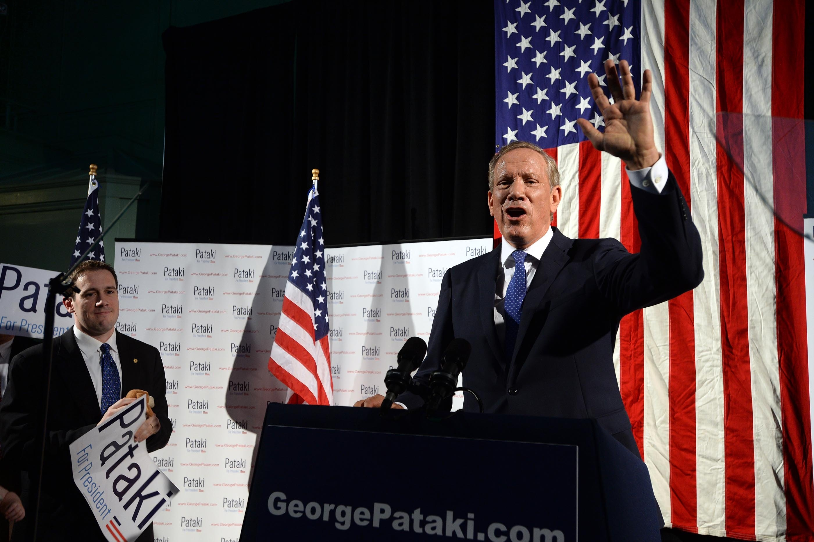Former New York Gov. George E. Pataki announces candidacy for Republican presidential nomination at Old Town Hall in Exeter, N.H., emphasizing less government, lower taxes, tolerance for immigration, strong defense and global leadership from the White House.