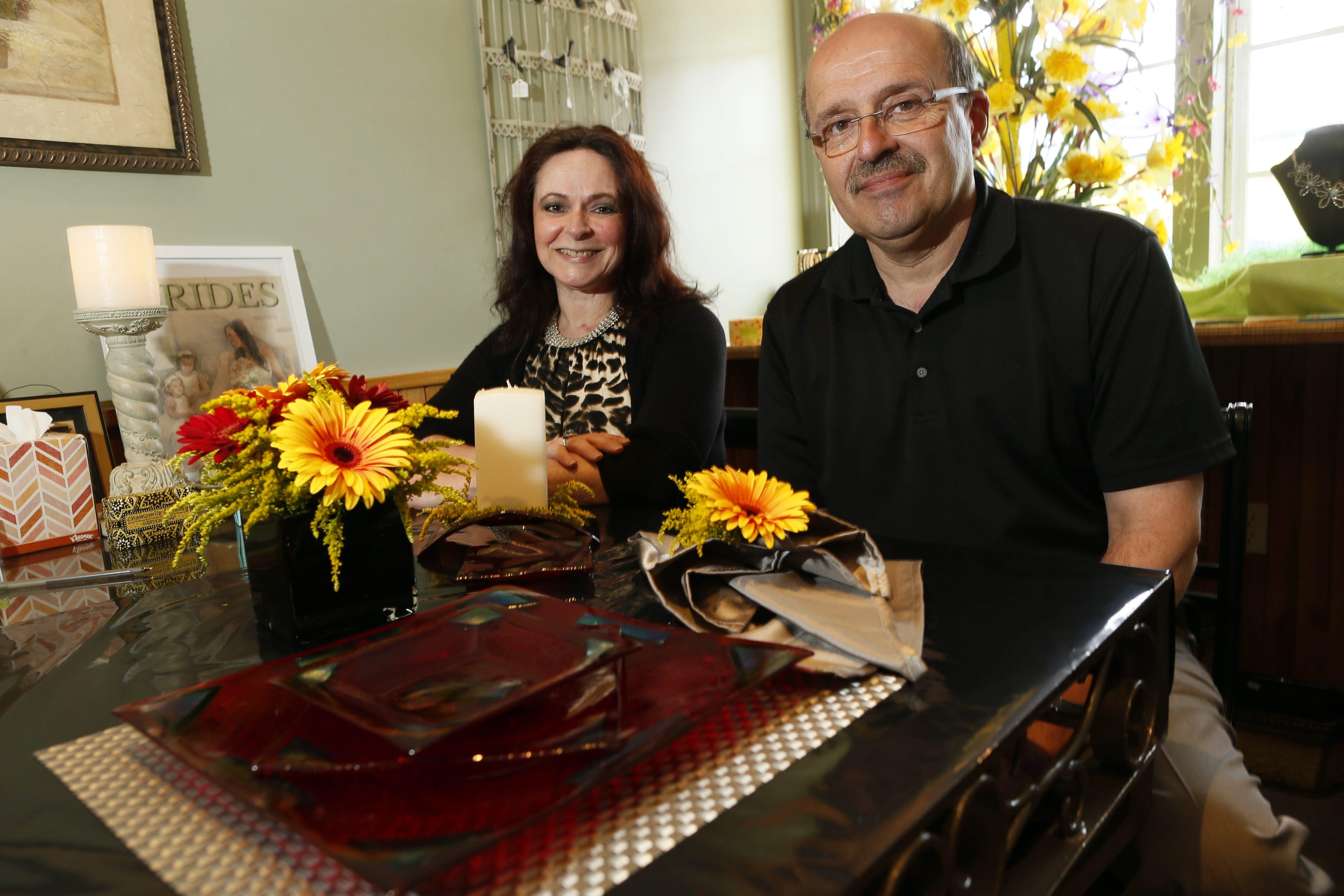 Designers Roz DiBacco, left, and Al Piccirillo will be designing tables capes for the upcoming Lewiston Tour of Kitchens.  They pose for photos at Piccirillo's Florist in Niagara Falls, Tuesday, May 26, 2015.  (Derek Gee/Buffalo News)