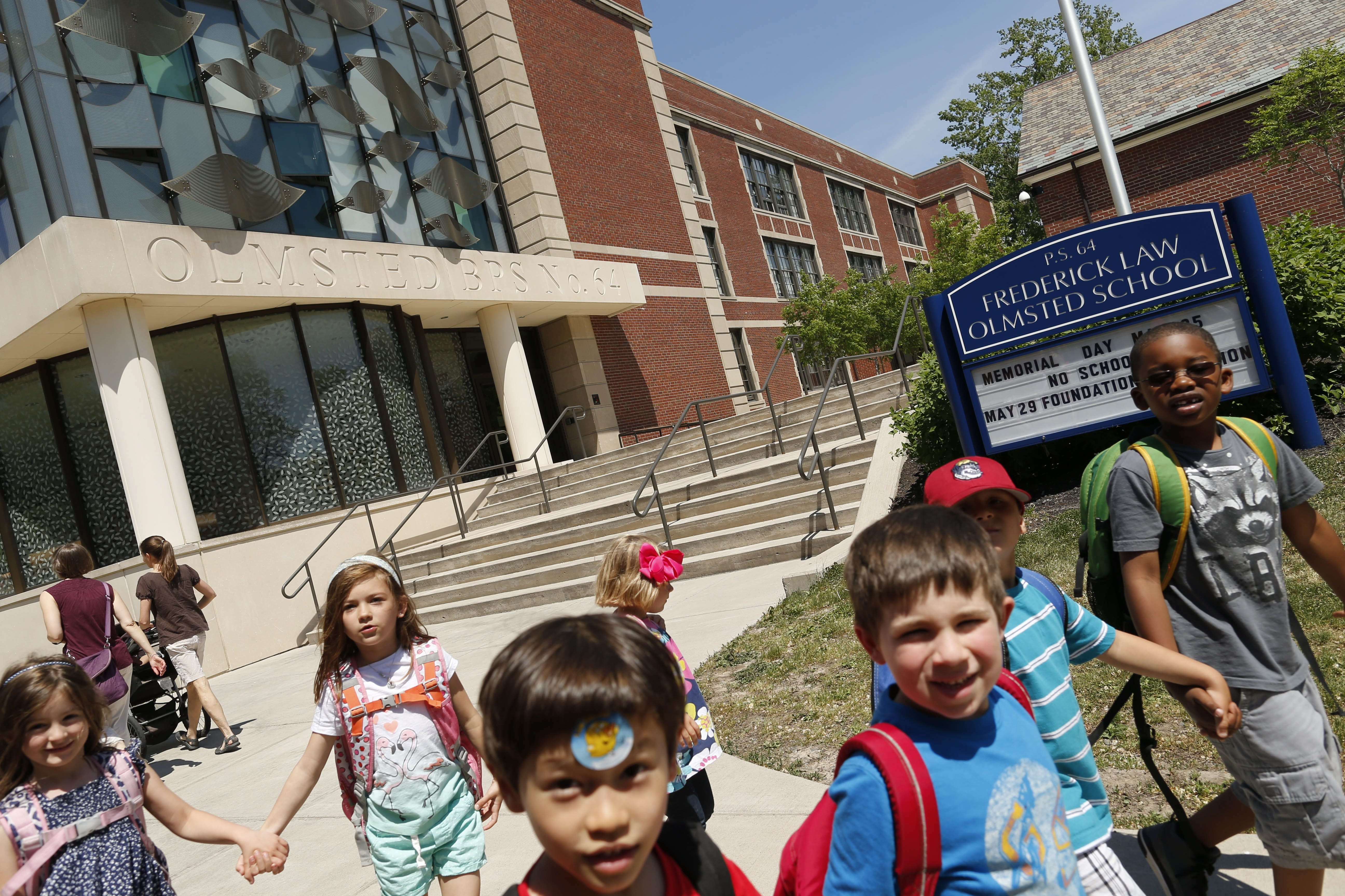 Students leave Olmsted School 64 at dismissal on Wednesday. Criteria-based schools such as Olmsted and City Honors were targeted in a report a civil rights expert presented Tuesday and Wednesday to the Buffalo School Board before Wednesday evening's board meeting.