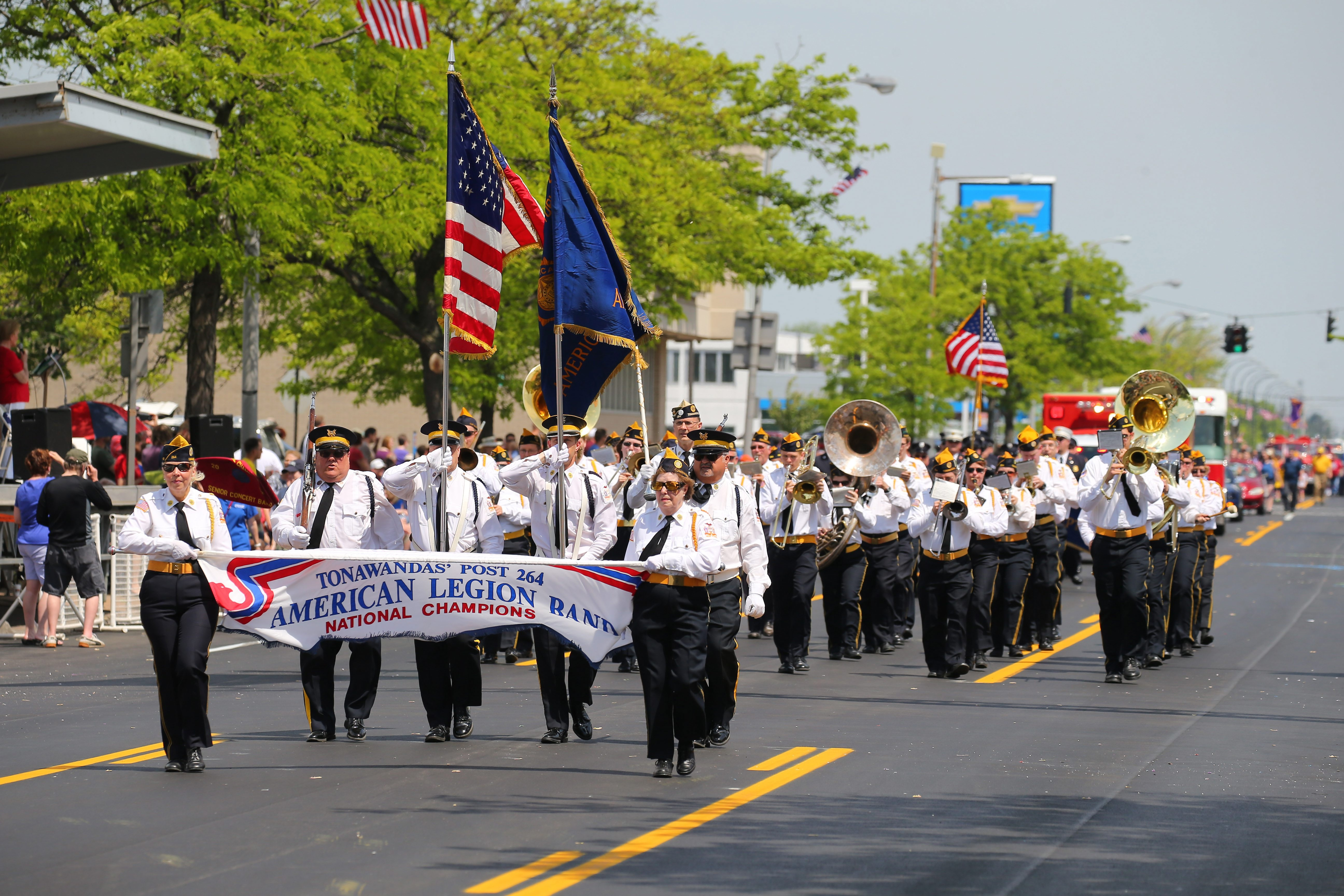 "Marching band from Tonawandas Post 264, American Legion, is among the units participating in the 68th annual Ken-Ton Memorial Day Parade on Delaware Avenue. Among the spectators was a boy, 11, who expressed pride ""because people serve for our country to keep us safe."""