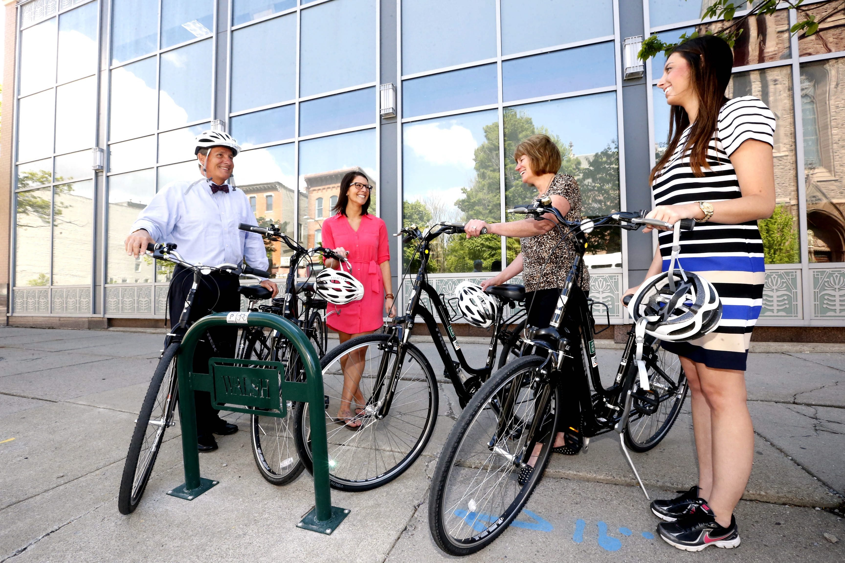 From left, Walsh Duffield chief operating officer Ted Walsh and fellow employees Karen Miranda, Kim Colvin and Megan Spiegelhoff get ready to take a company bike ride last week.